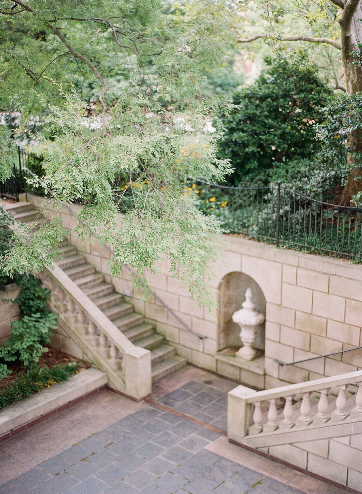 wedding venue staircases on either side of courtyard garden
