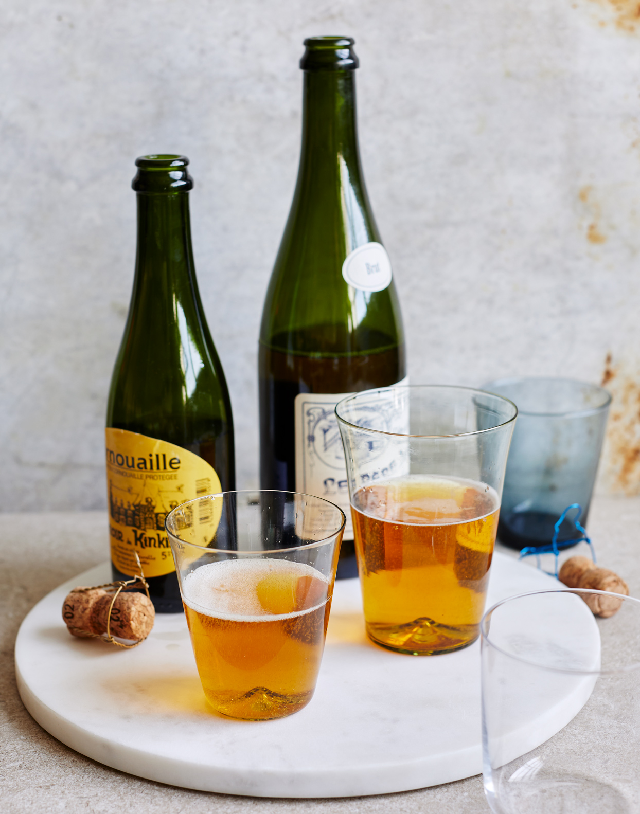 lambic beer bottles with drinks in cups