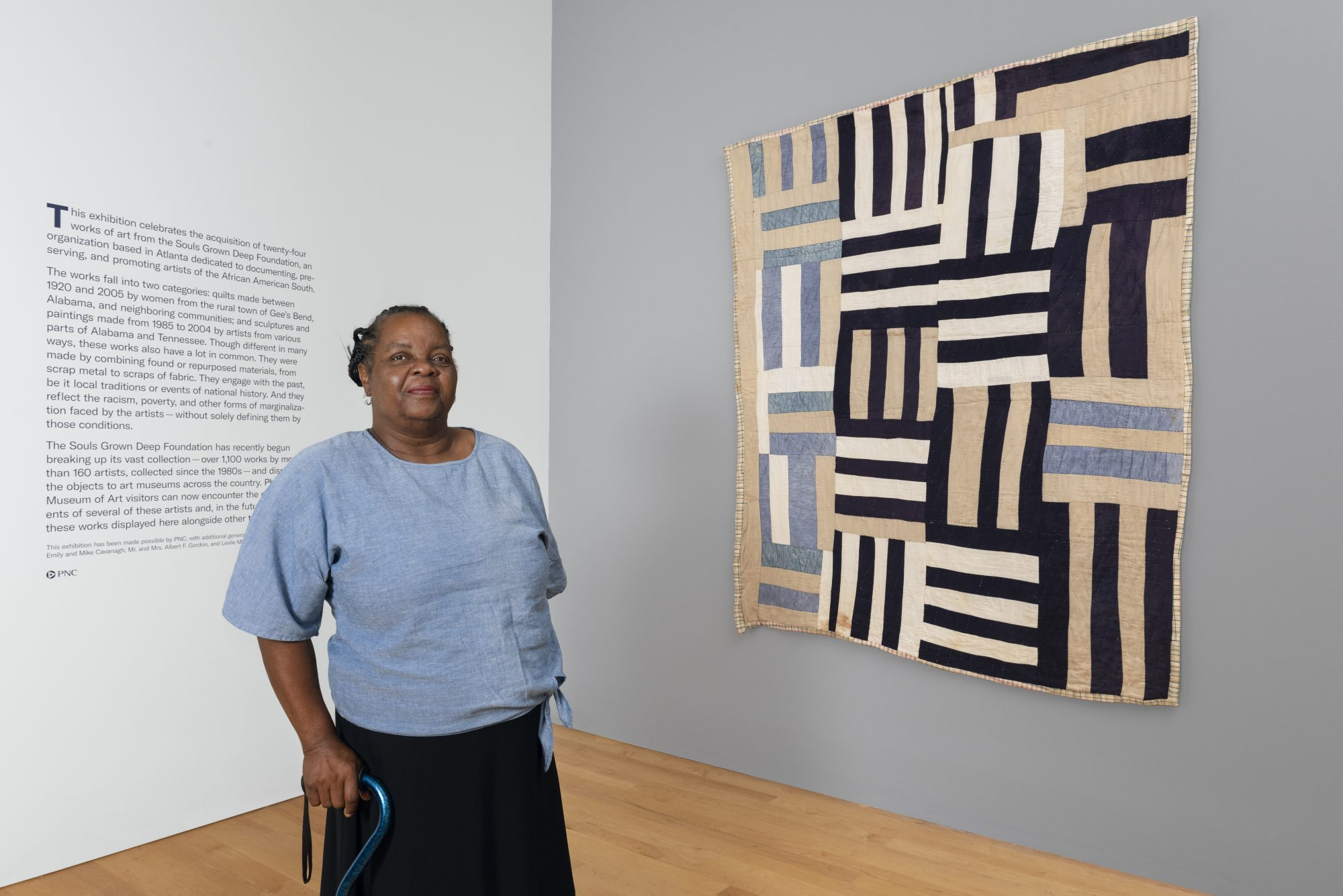 """Gee's Bend quilter Mary Margaret Pettway in the exhibition """"Souls Grown Deep: Artists of the African American South"""" at the Philadelphia Museum of Art."""