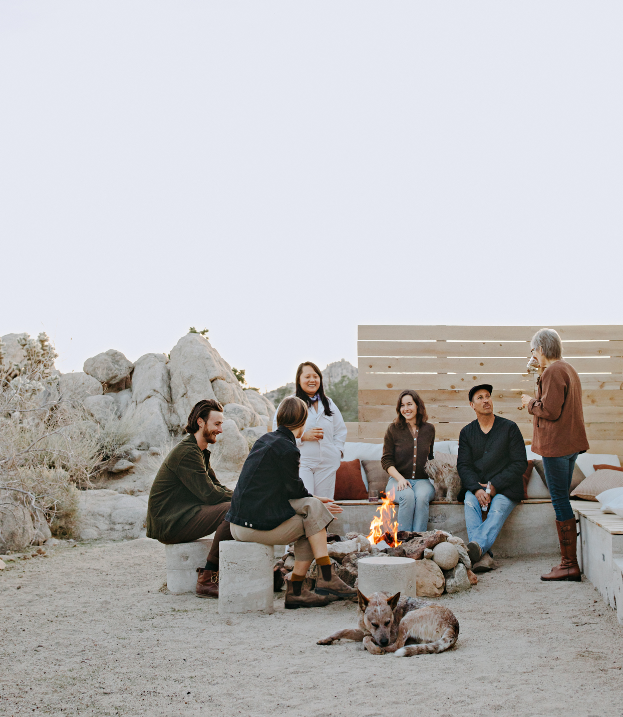 gathering with friends at their Joshua Tree home