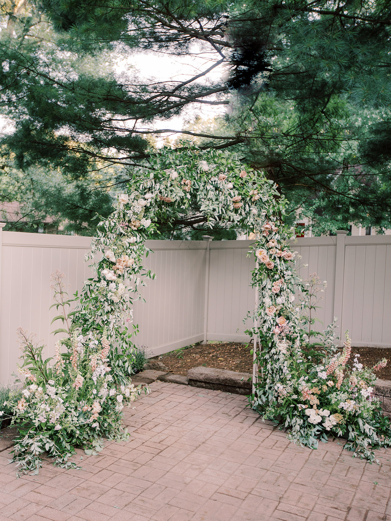 marina evan wedding flower arch ceremony