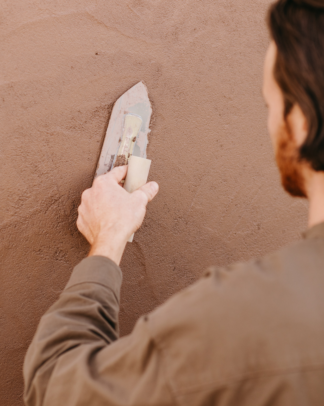 adding plaster to a wall