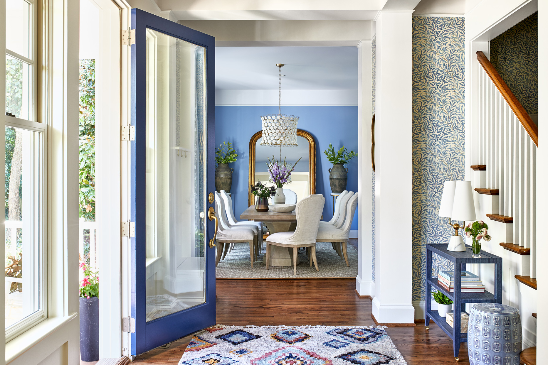 entryway with chicago blue-painted front door