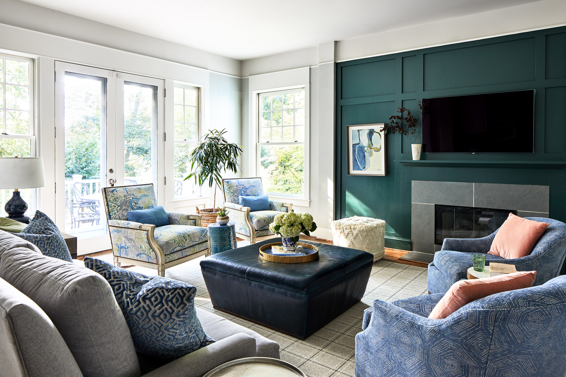 family room with deep green-painted statement wall