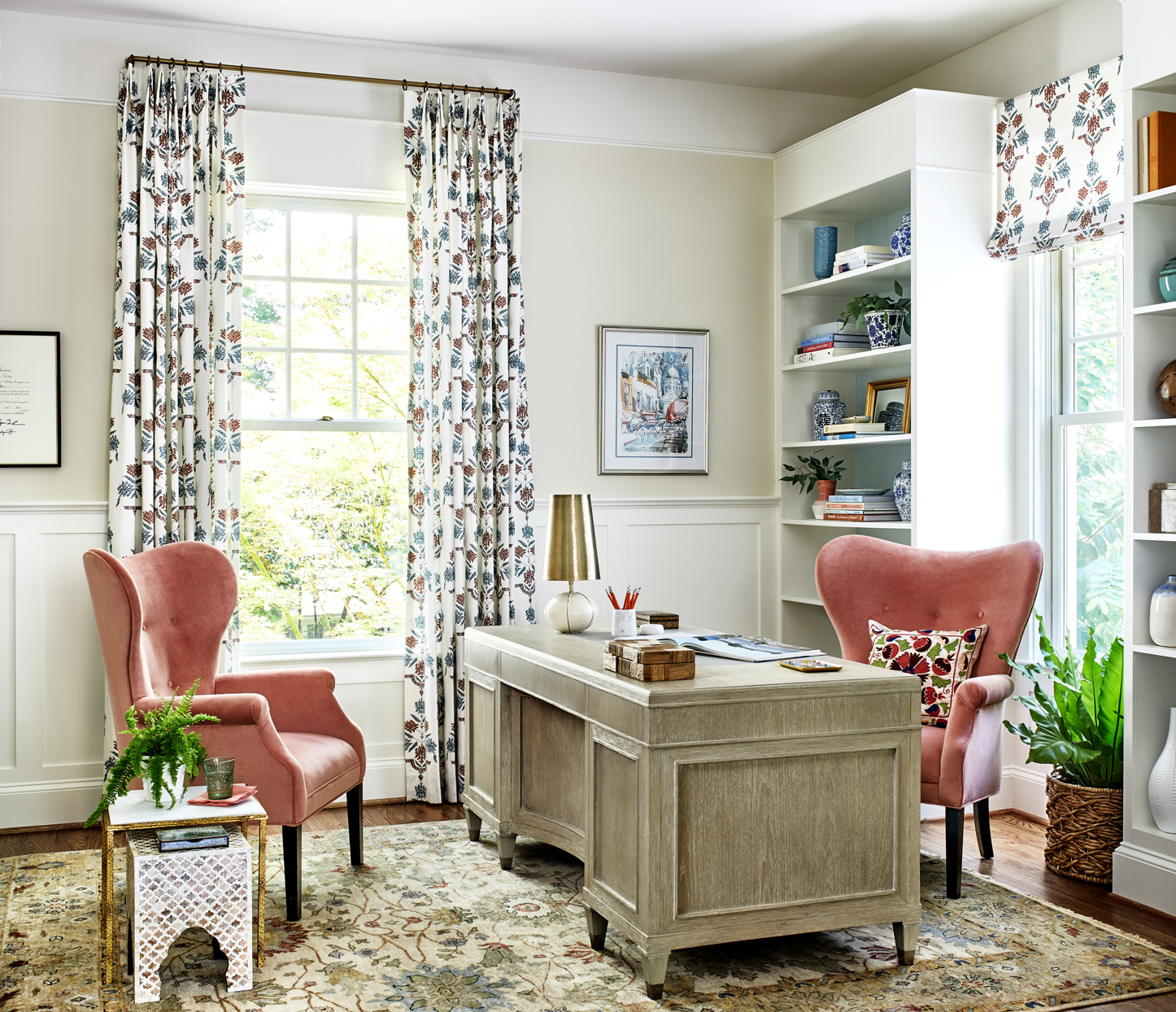 home office with two coral velvet wing chairs