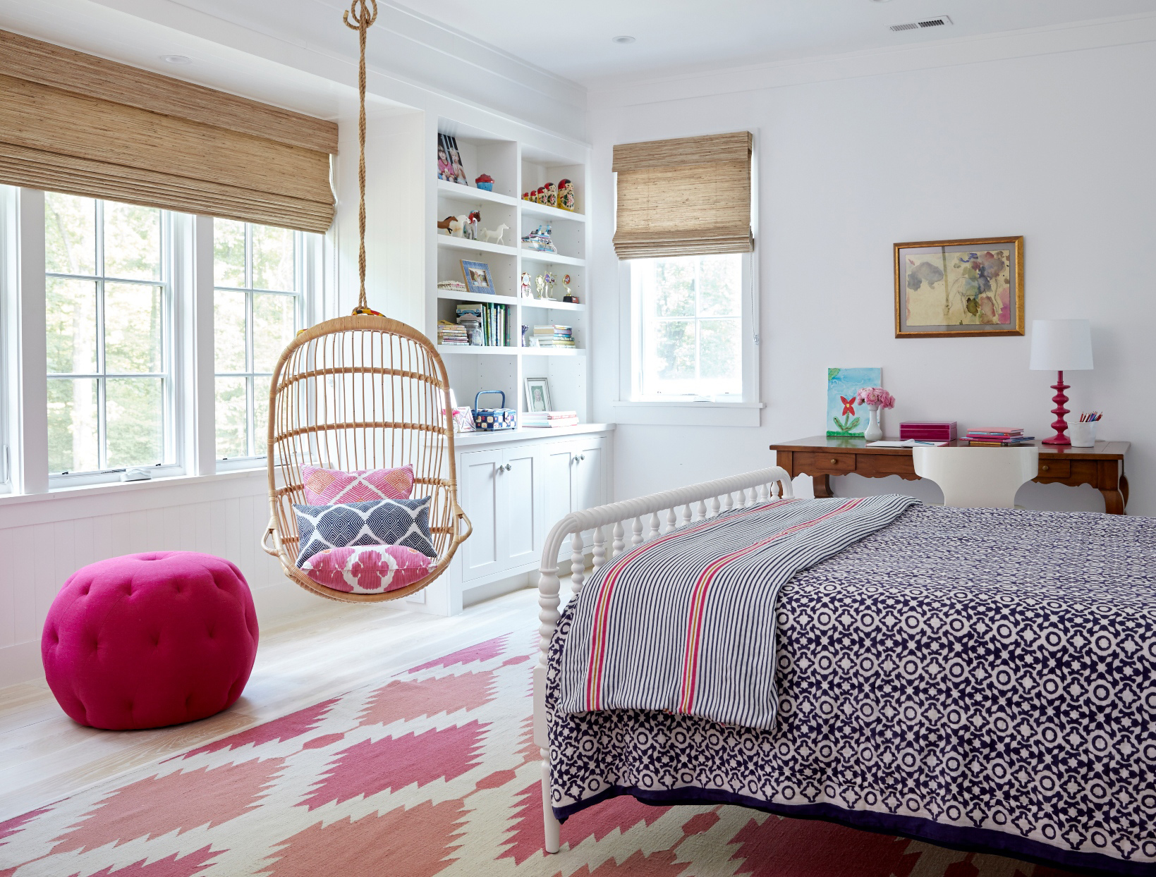 bedroom decorated with hues of pink and purple