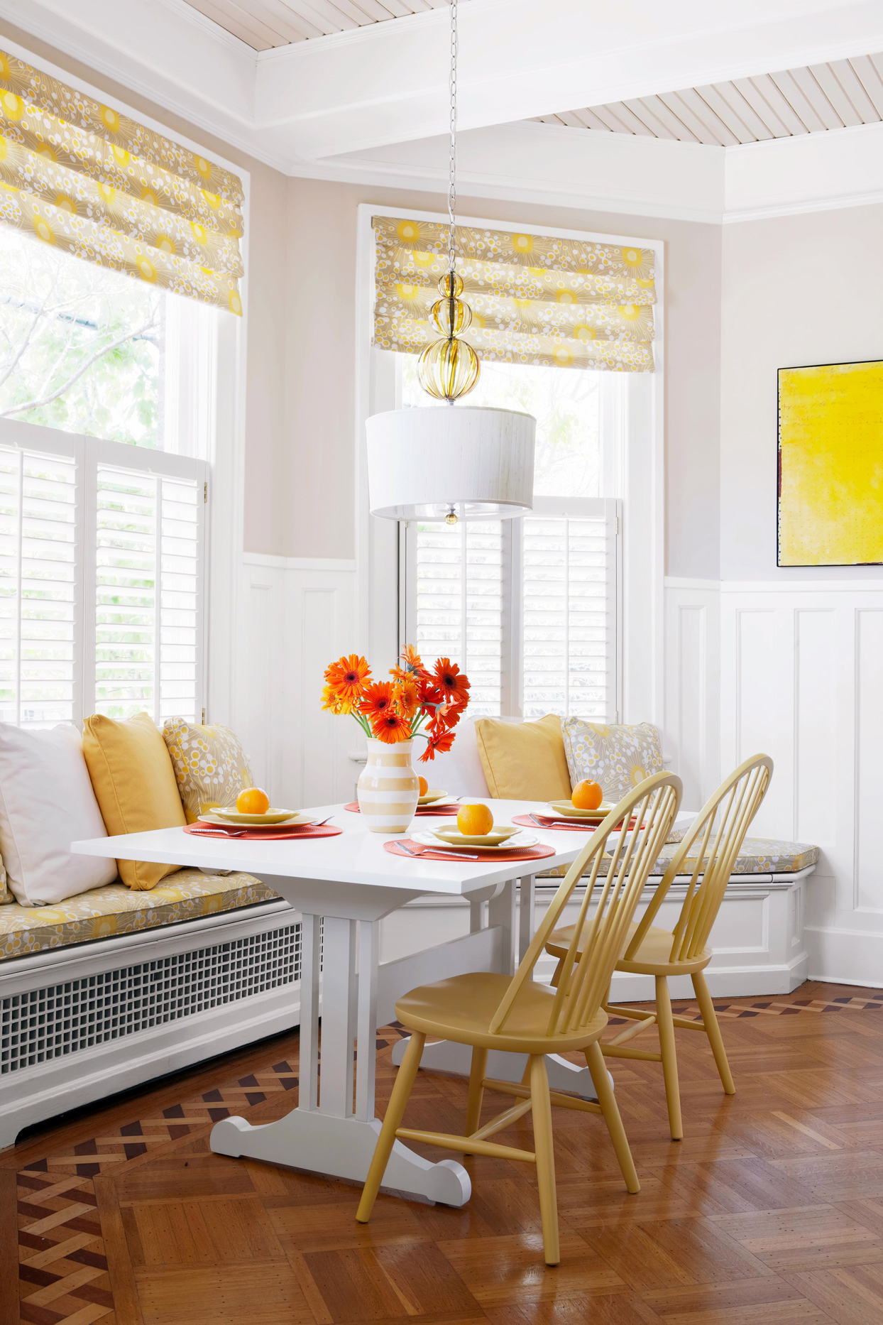 kitchen decorated in yellow, orange, and white