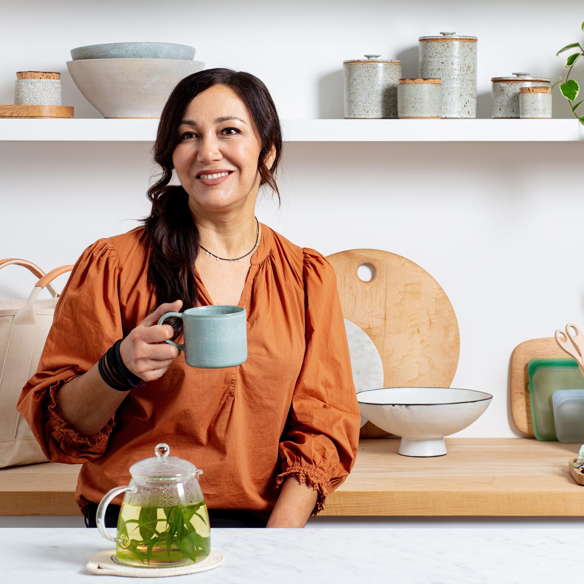 Stasher Bags founder Kat Nouri holding mug of tea