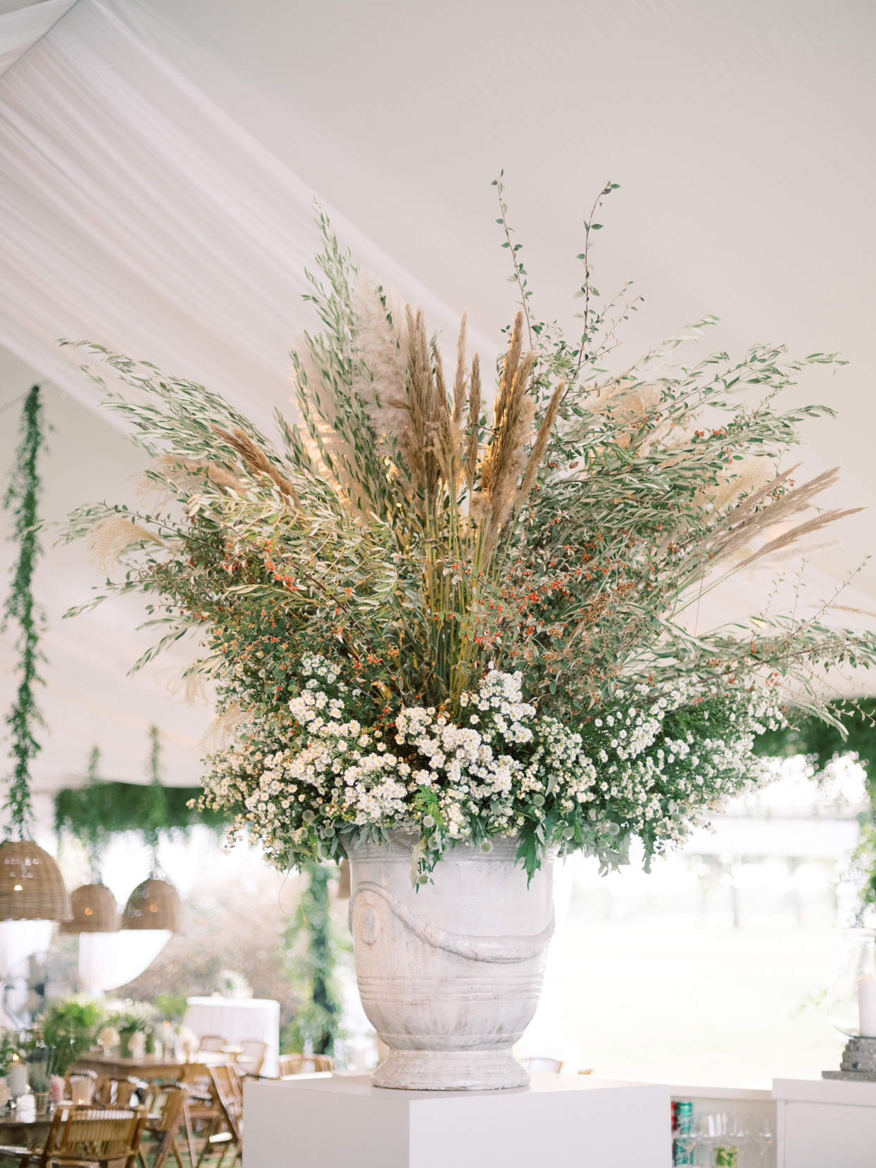 wedding bar with large urn of wildflowers