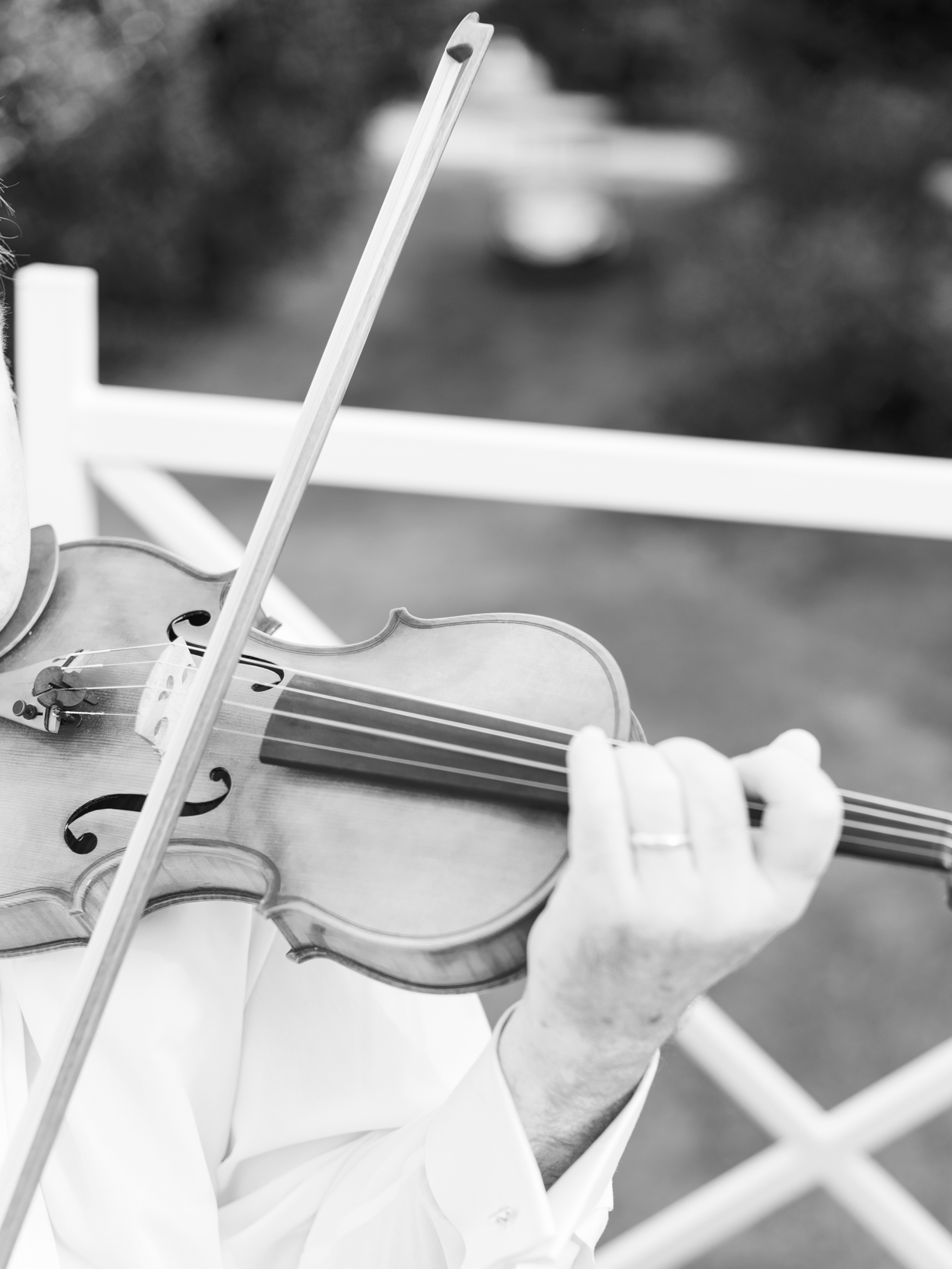 close up of violinist playing during wedding ceremony