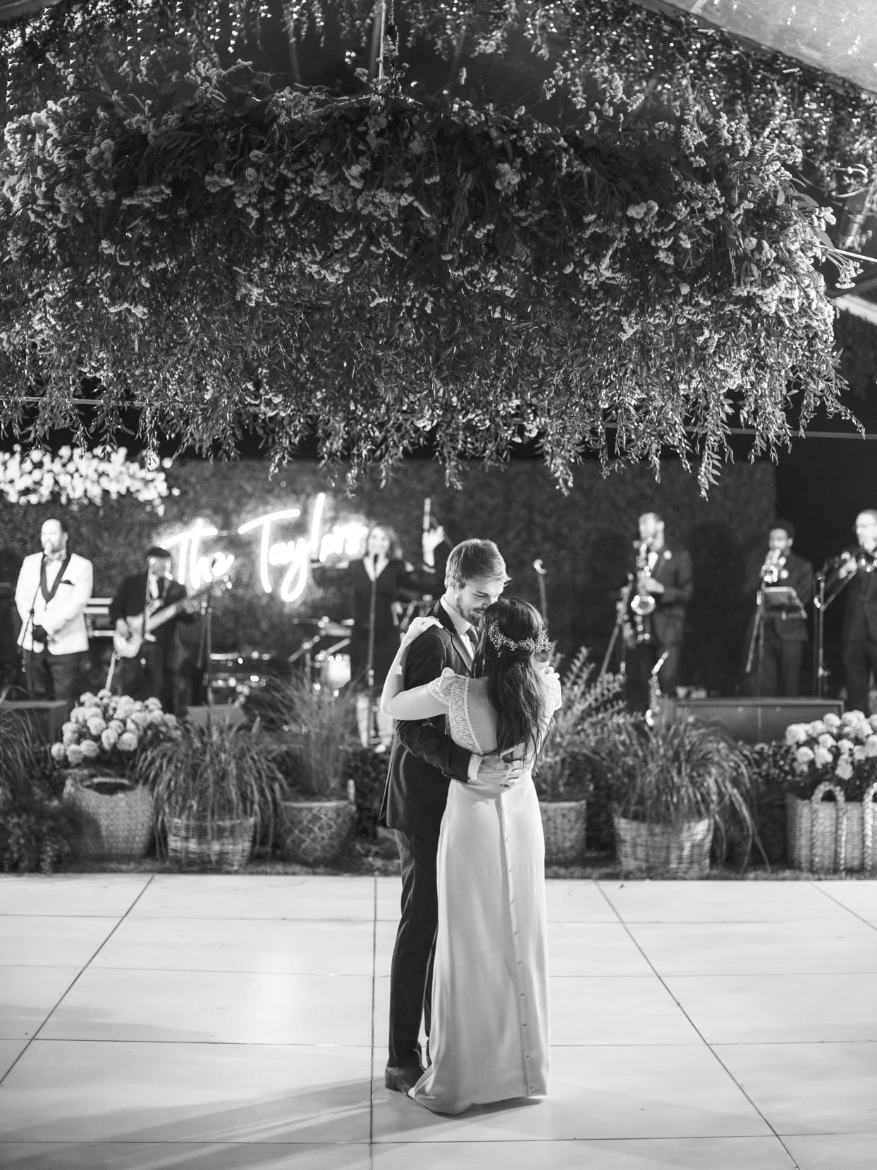 bride and groom first dance in wedding reception tent