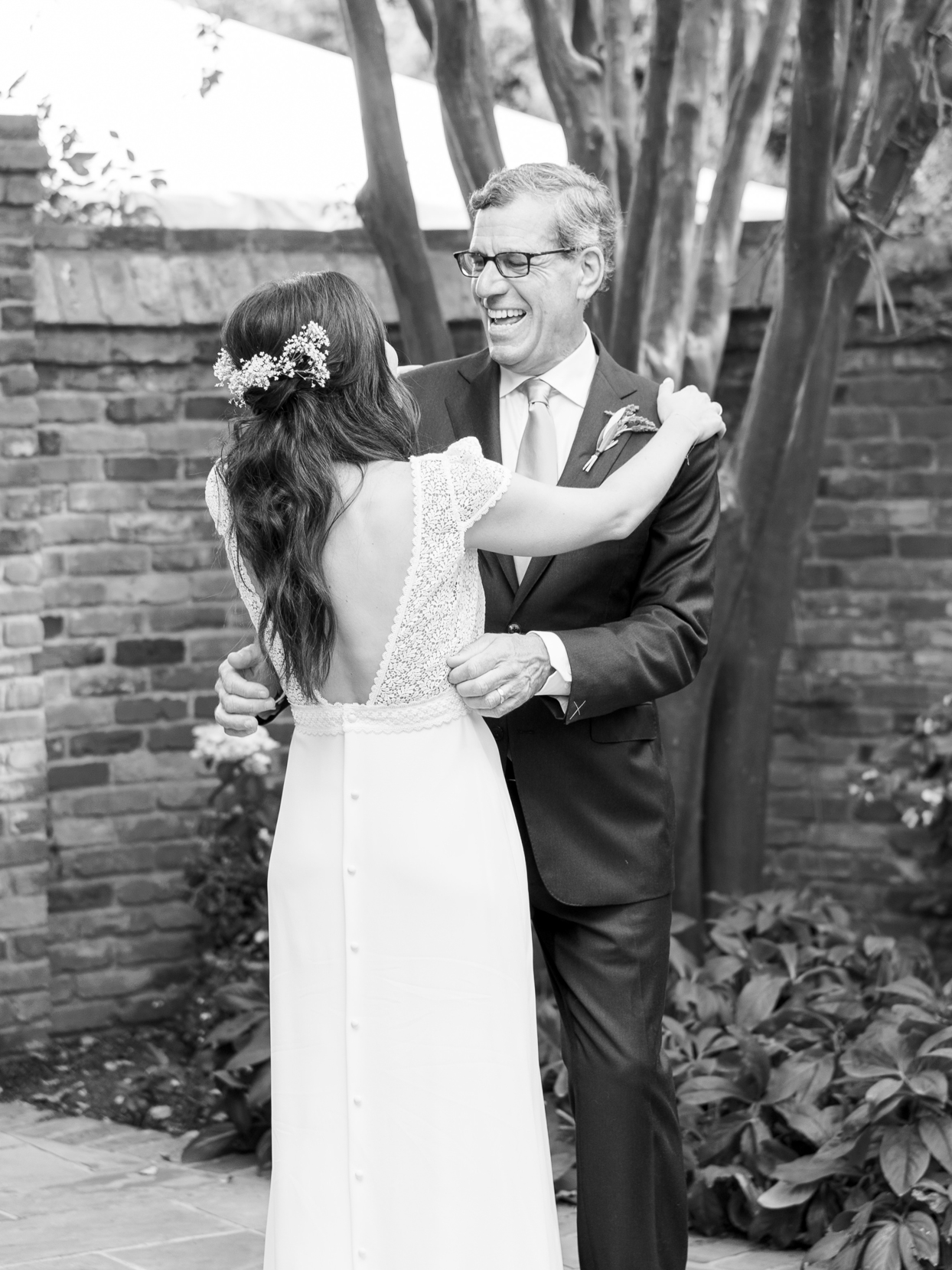 bride hugging father during first look