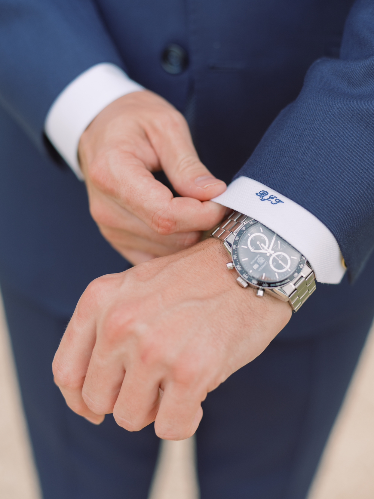 groom's adjusting sleeve with personalized initials on the cuff