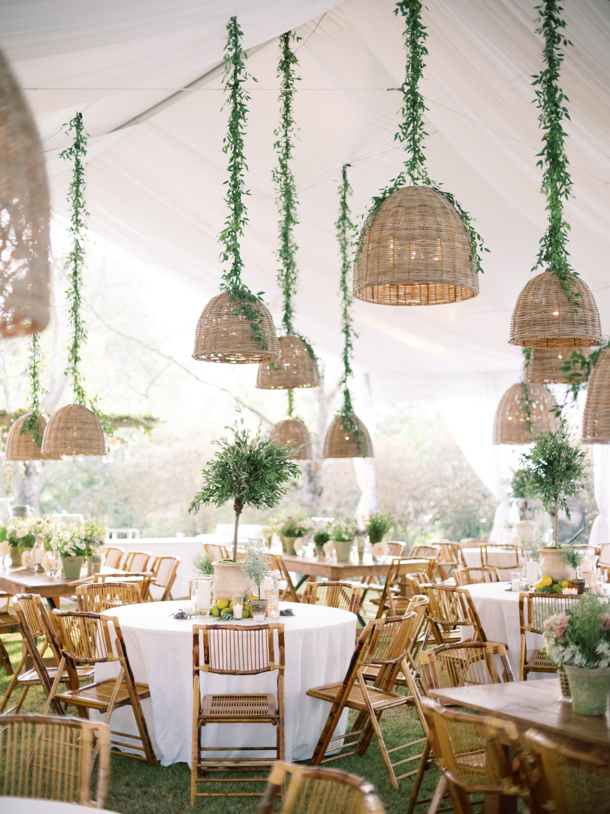 white and wooden reception set up with elegant greenery