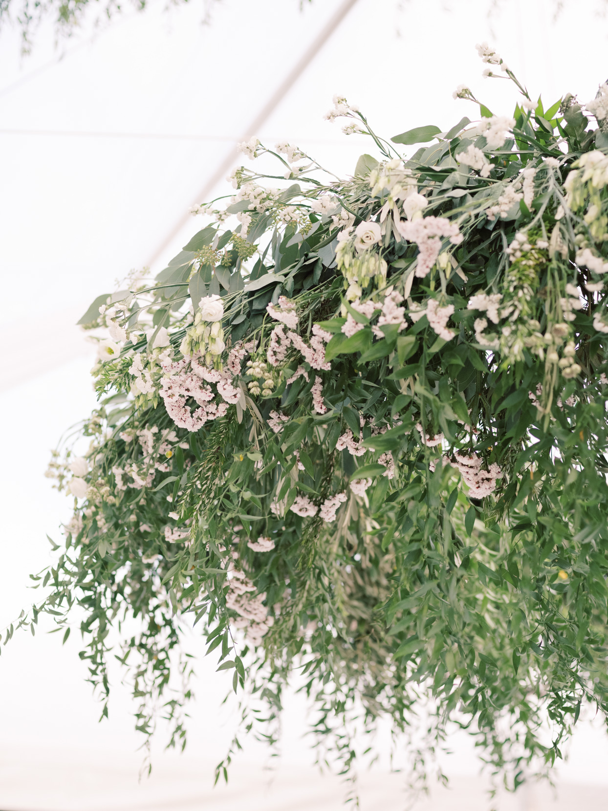 hanging greenery and floral tent installation