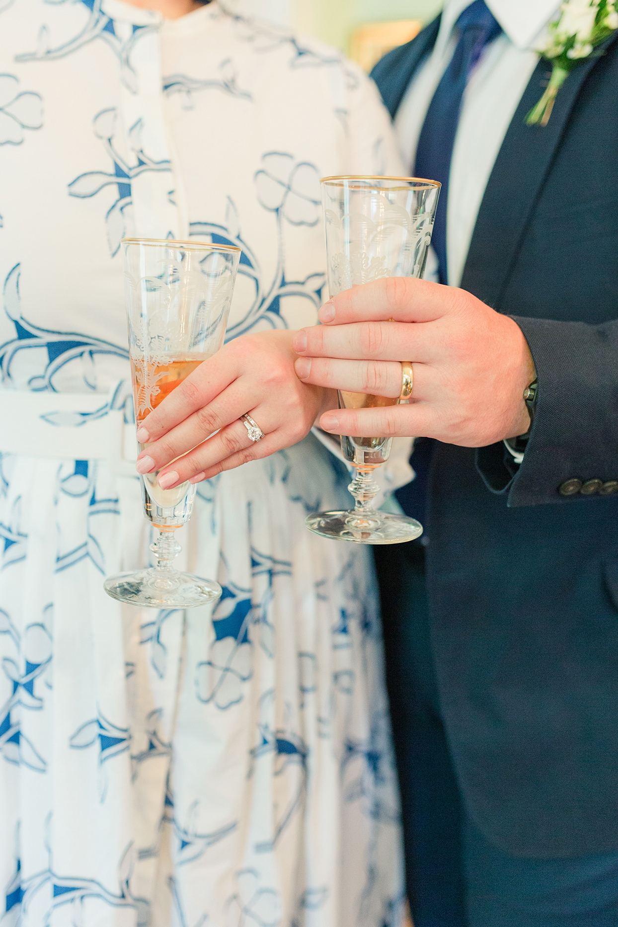 bride and groom hold champagne glasses