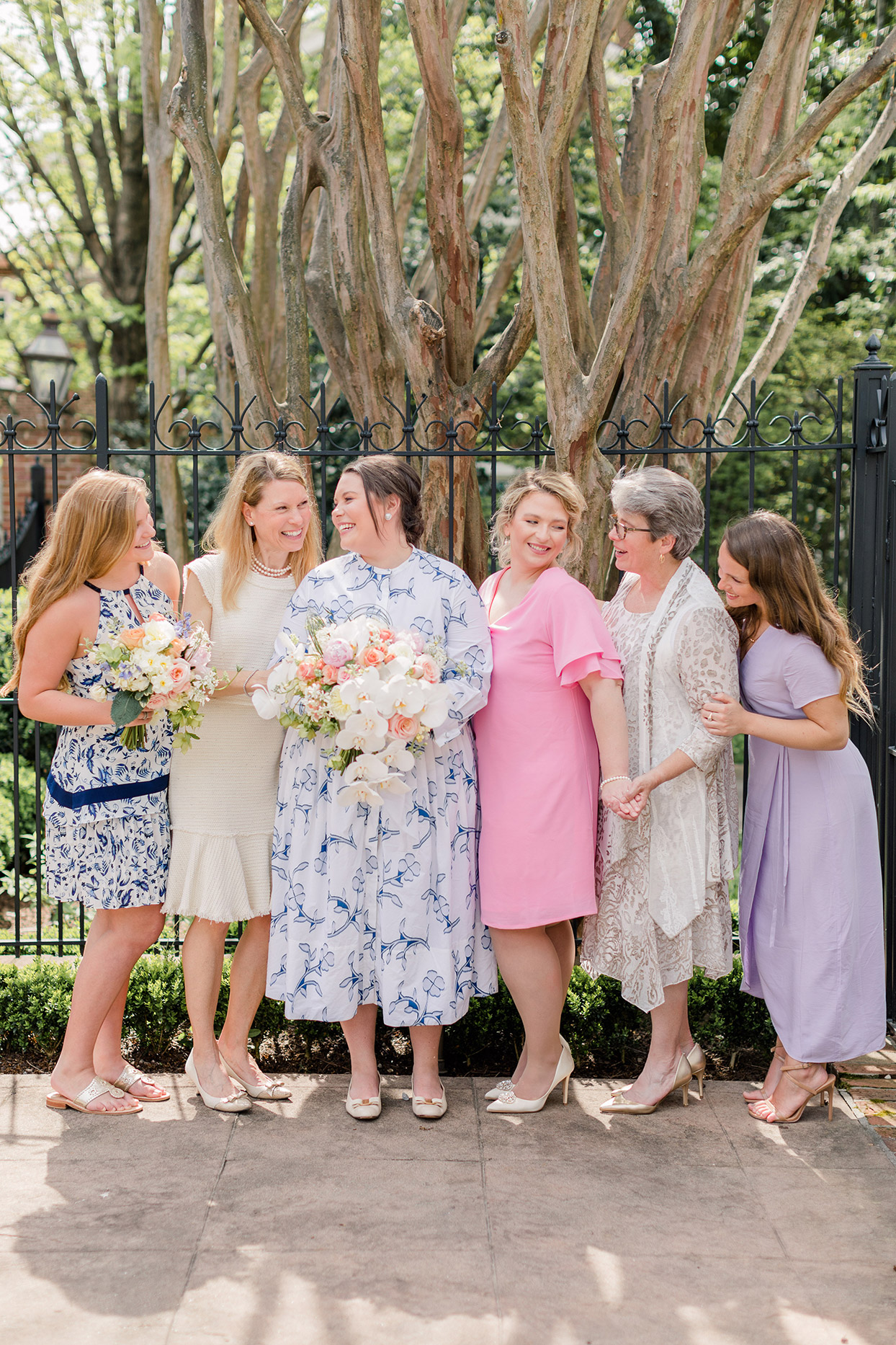 bride standing with female family members