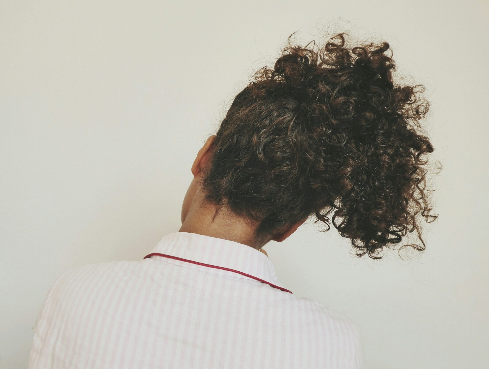 woman with curly hair in updo