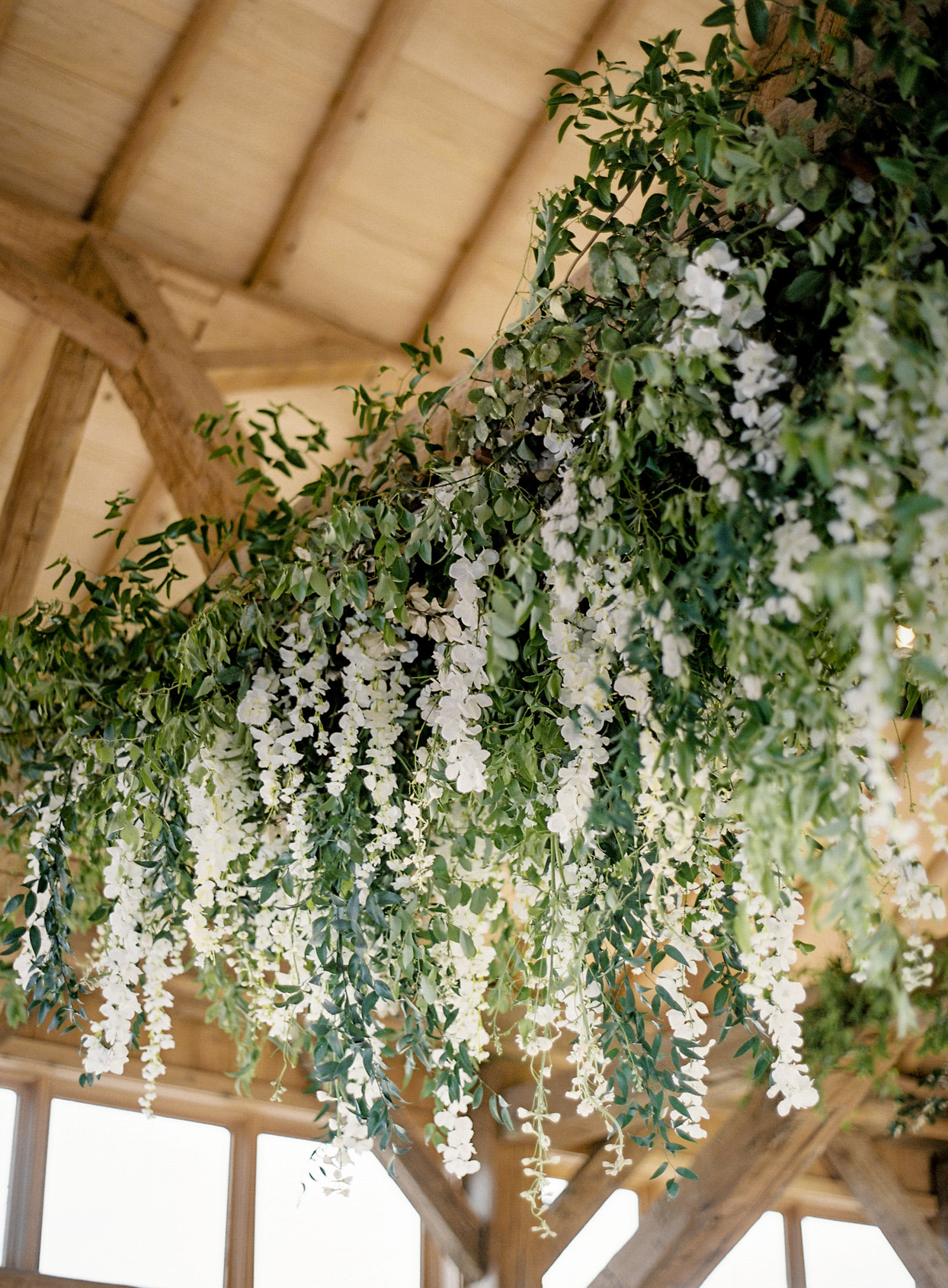 white floral and greenery hanging from ceiling