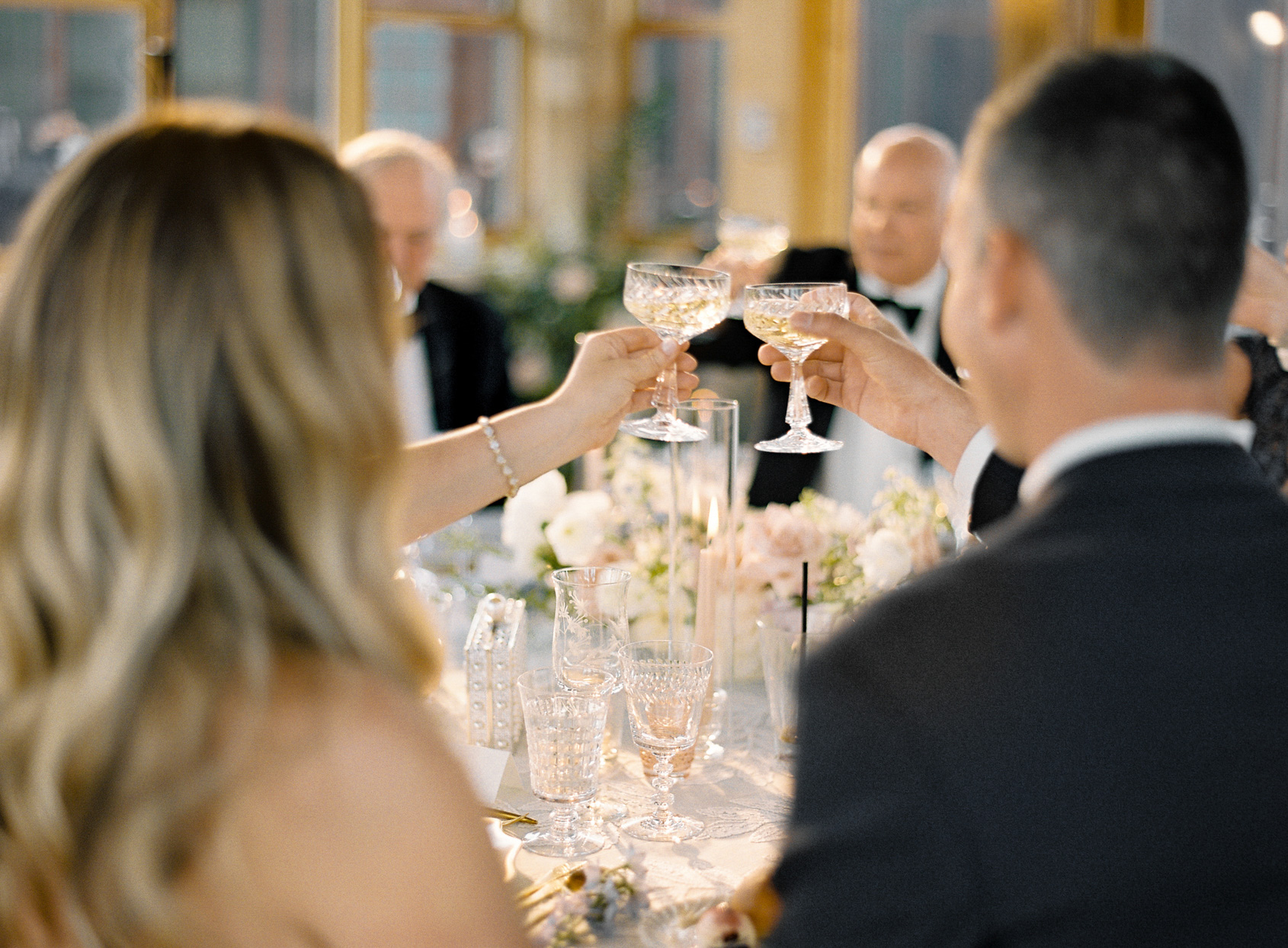 bride and groom toasting at wedding reception