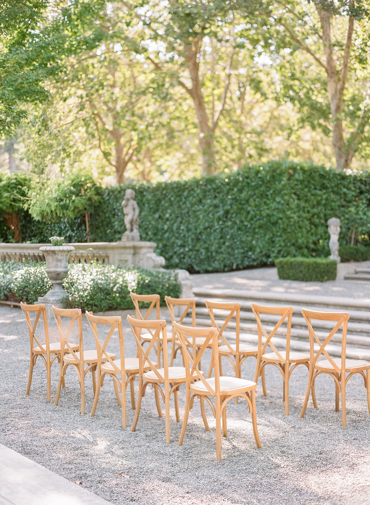 wooden ceremony chairs at outdoor wedding