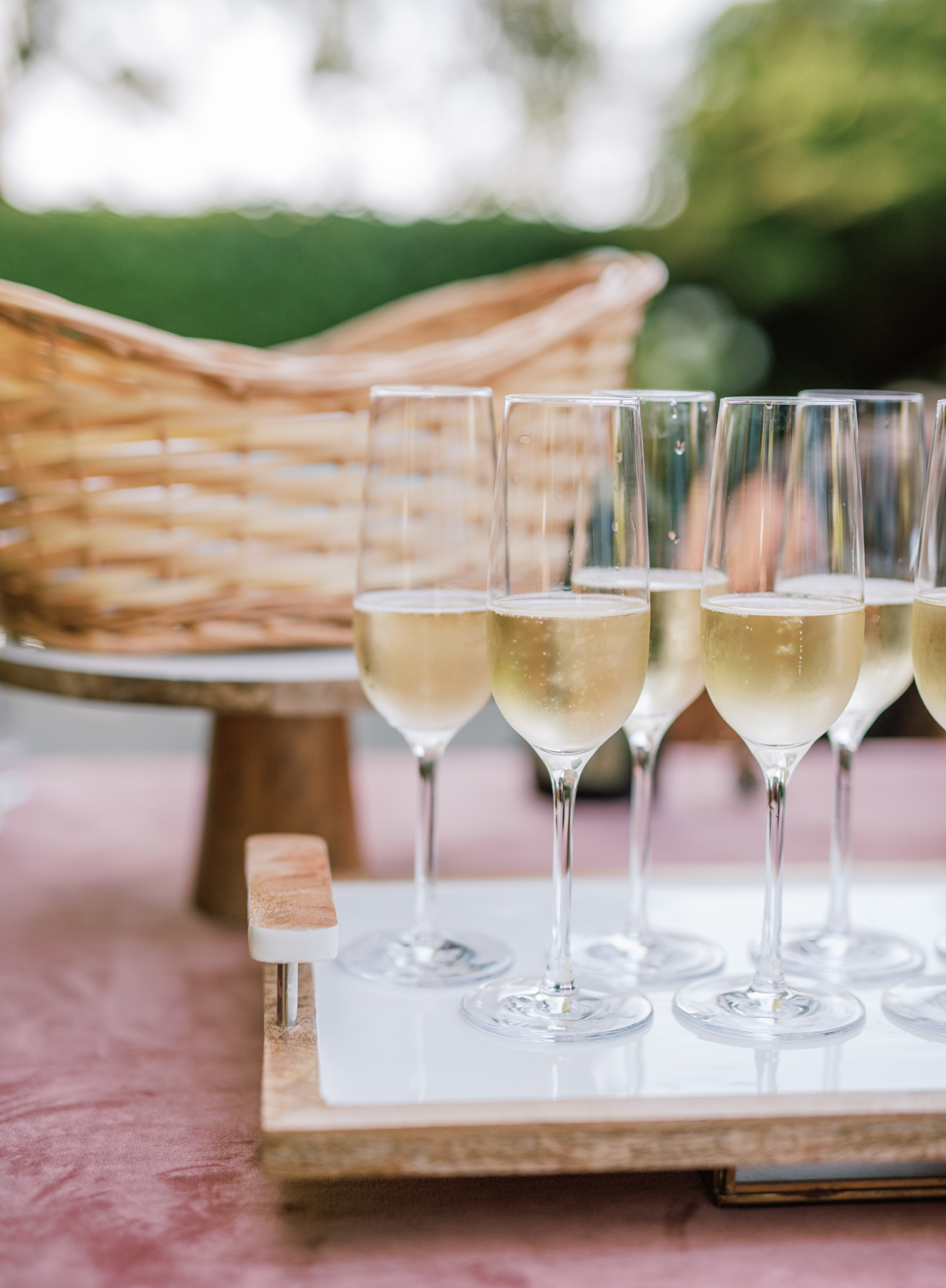 glasses of champagne on wooden serving tray