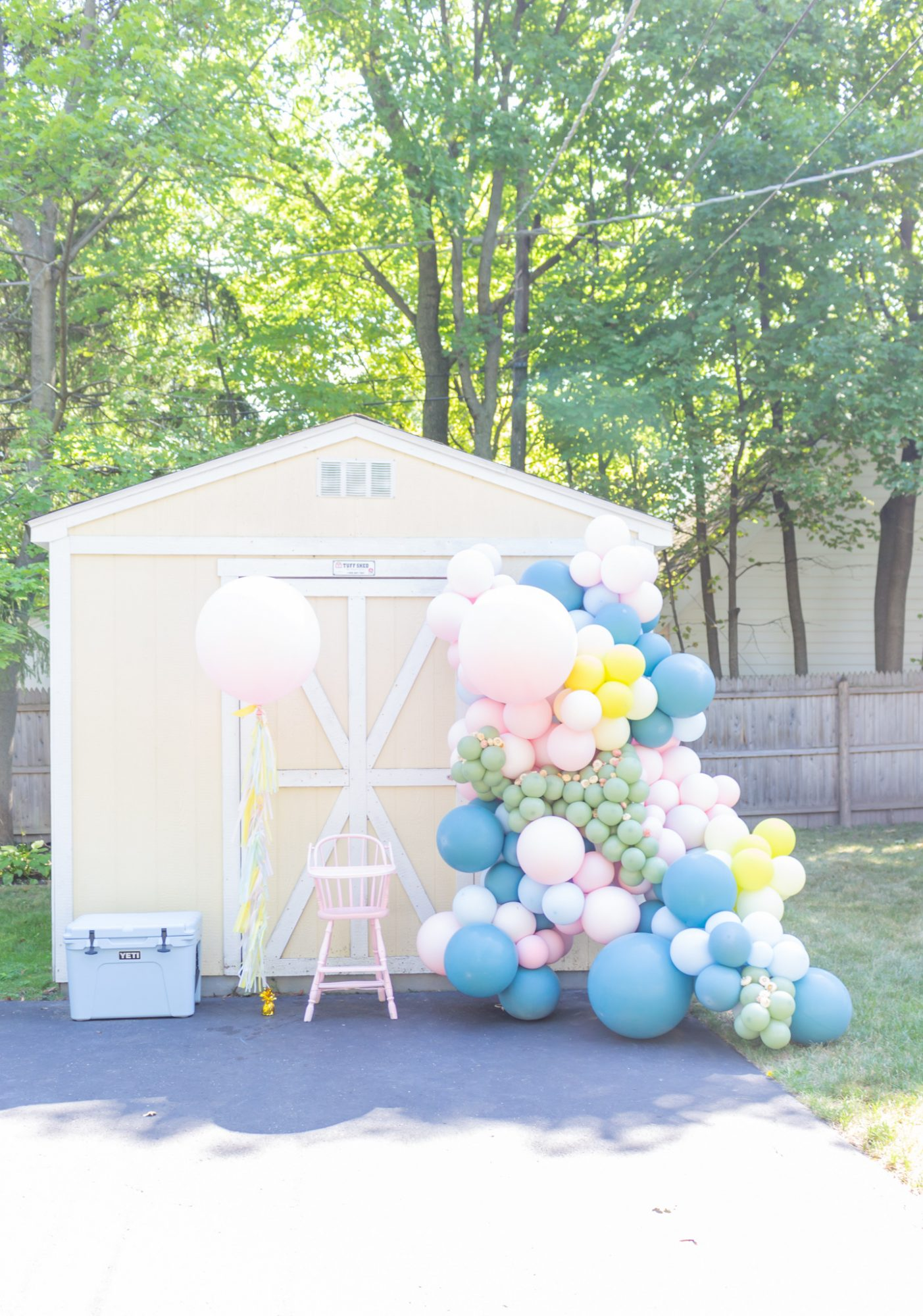 a decorated space for baby Claire's virtual birthday cake smash