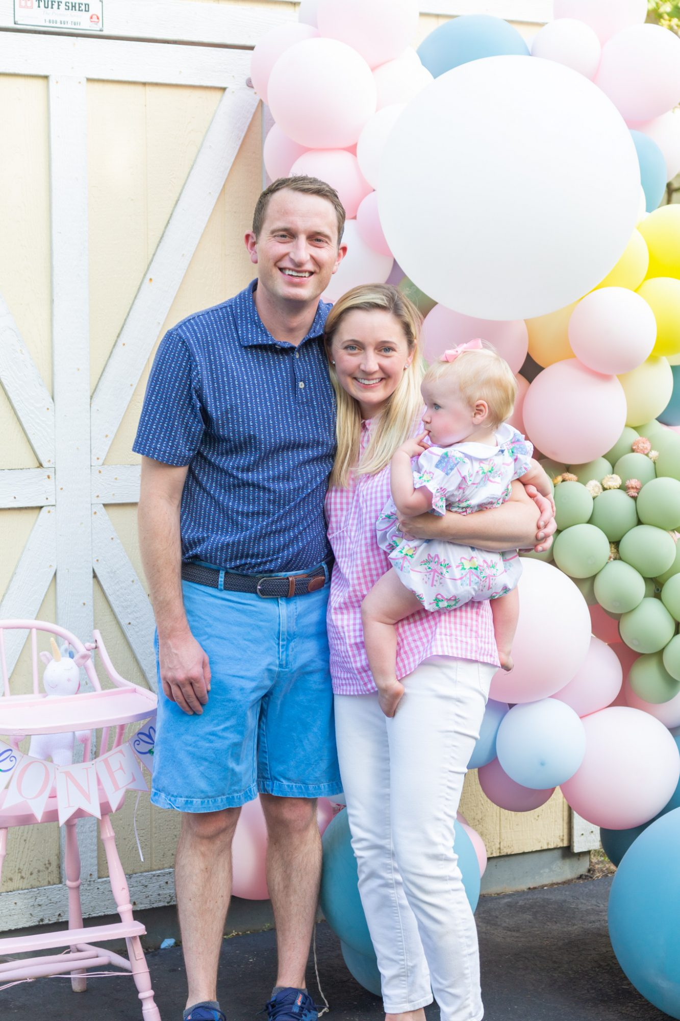 Parents and their baby, Claire, at her virtual birthday cake smash