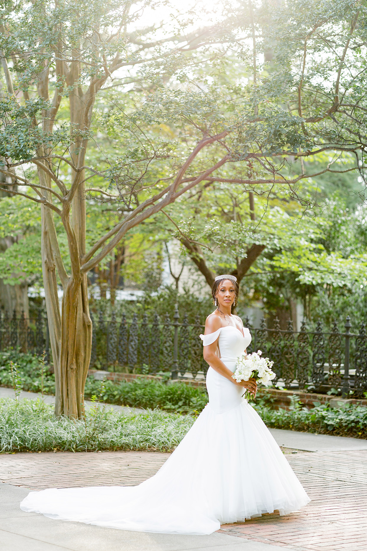bride wearing off the shoulder v neck tulle fit-and-flare wedding dress with train