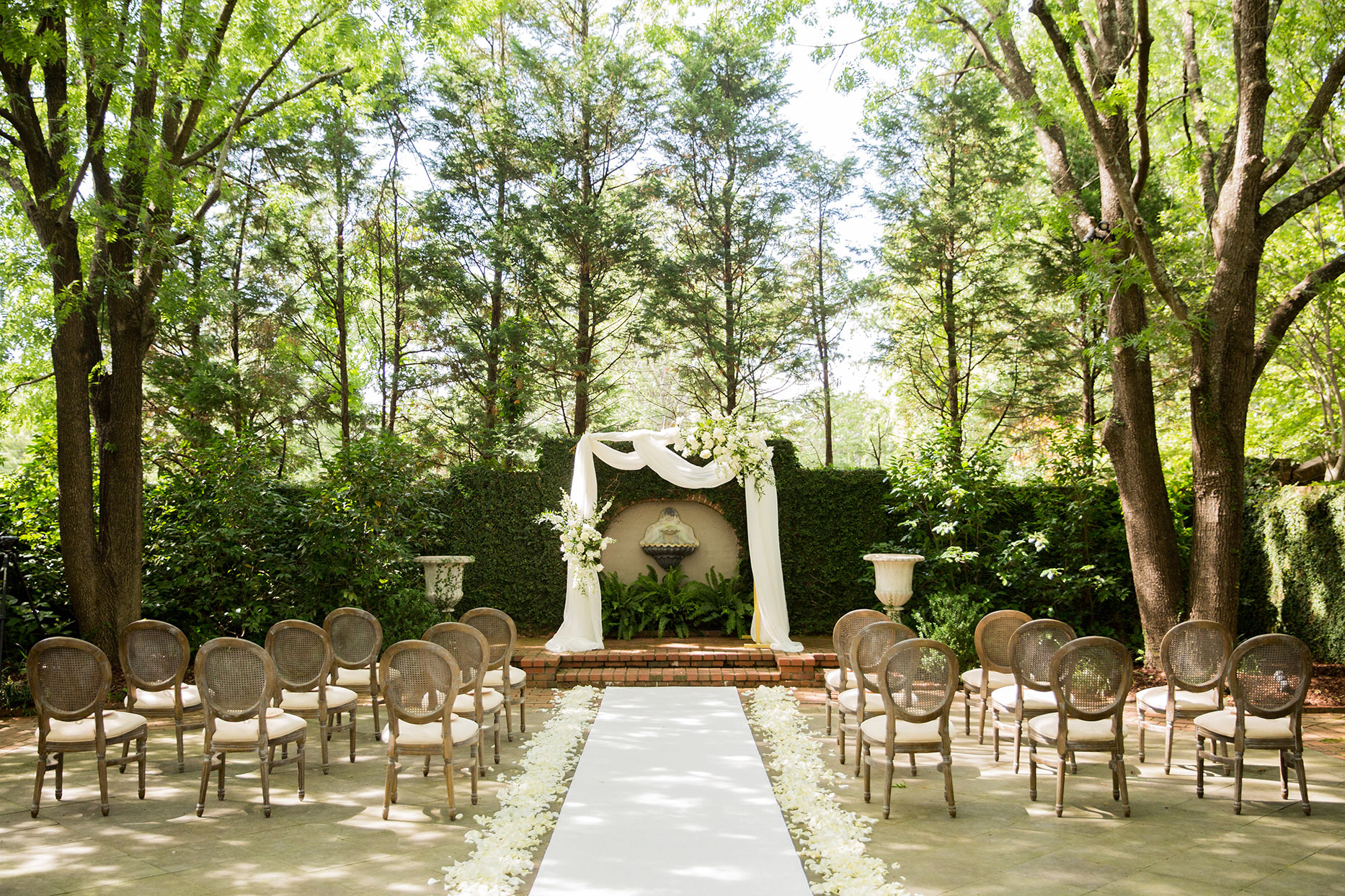 outdoor wedding ceremony set up with white floral accents