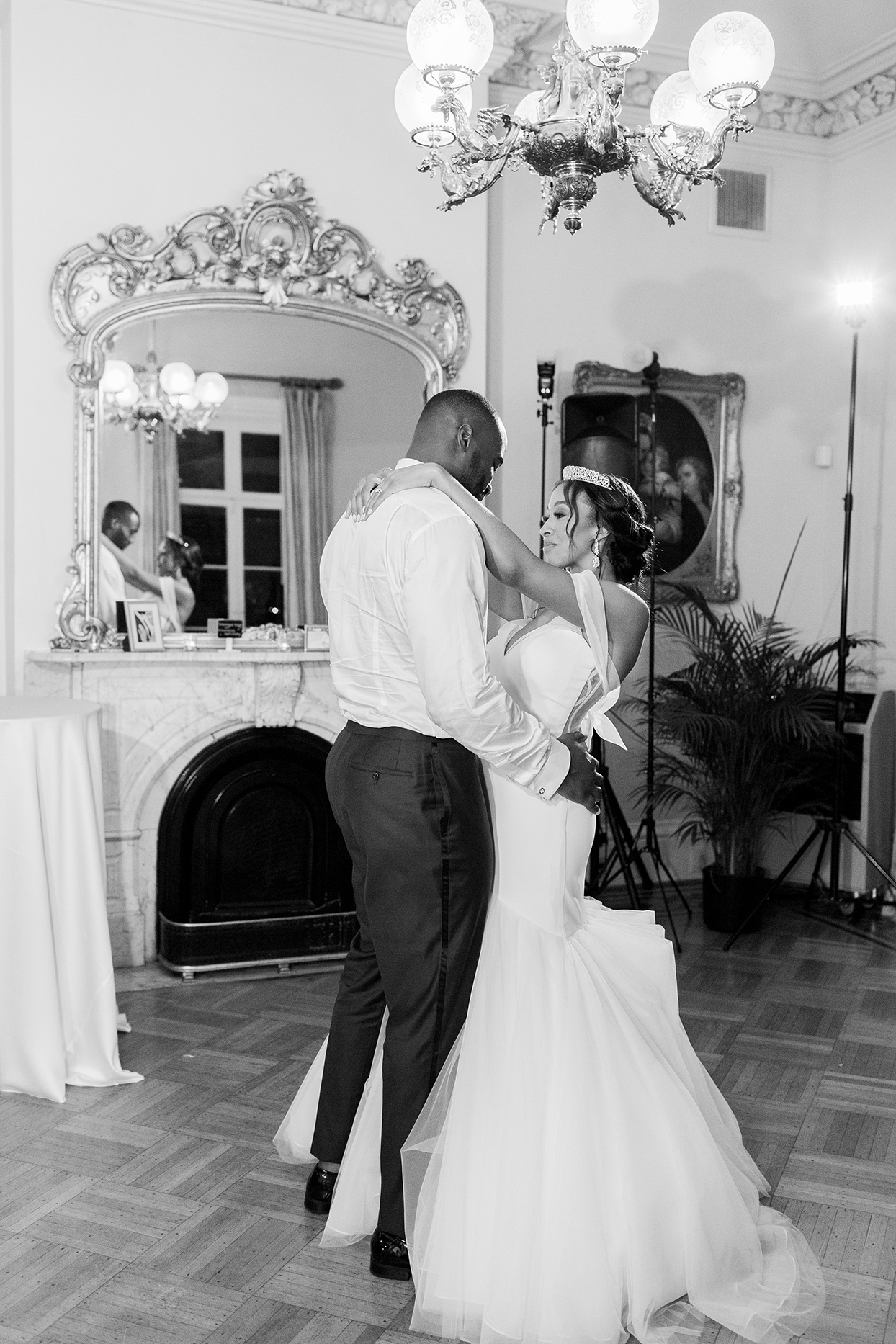 bride and groom sharing first dance indoors
