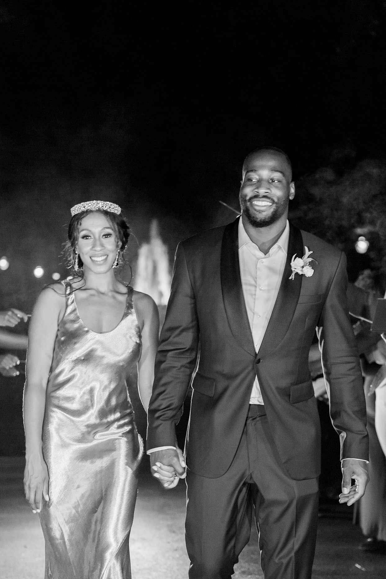 bride wearing gold satin slip gown holding hands with groom