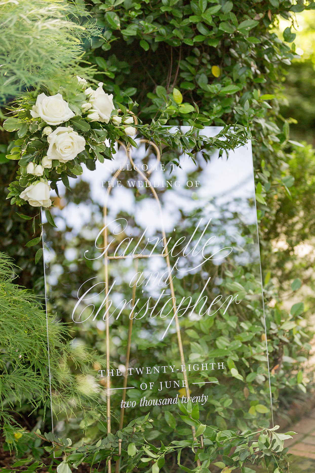 acrylic wedding sign with floral accent