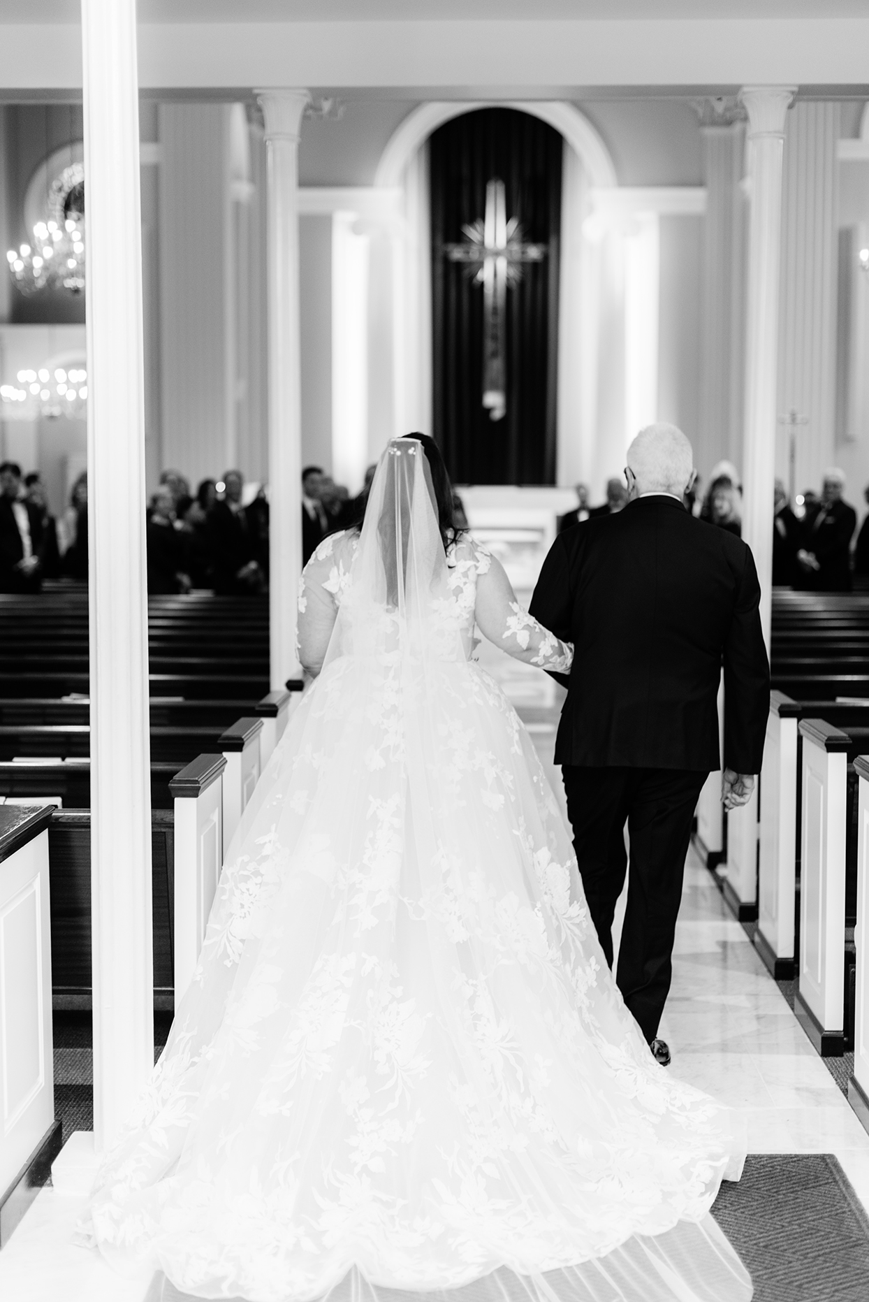 bride and father walking down aisle