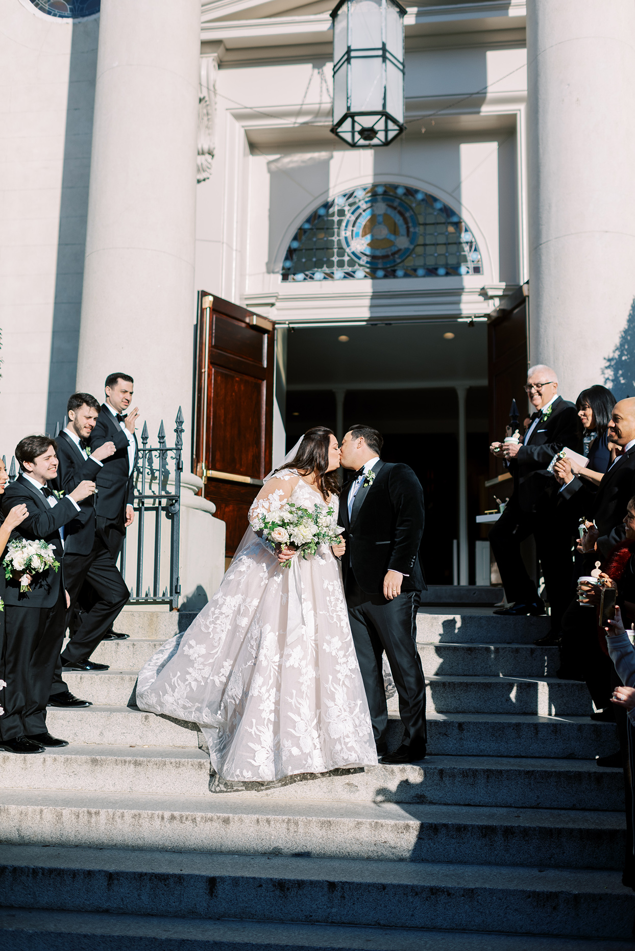 bride and groom kissing after ceremony
