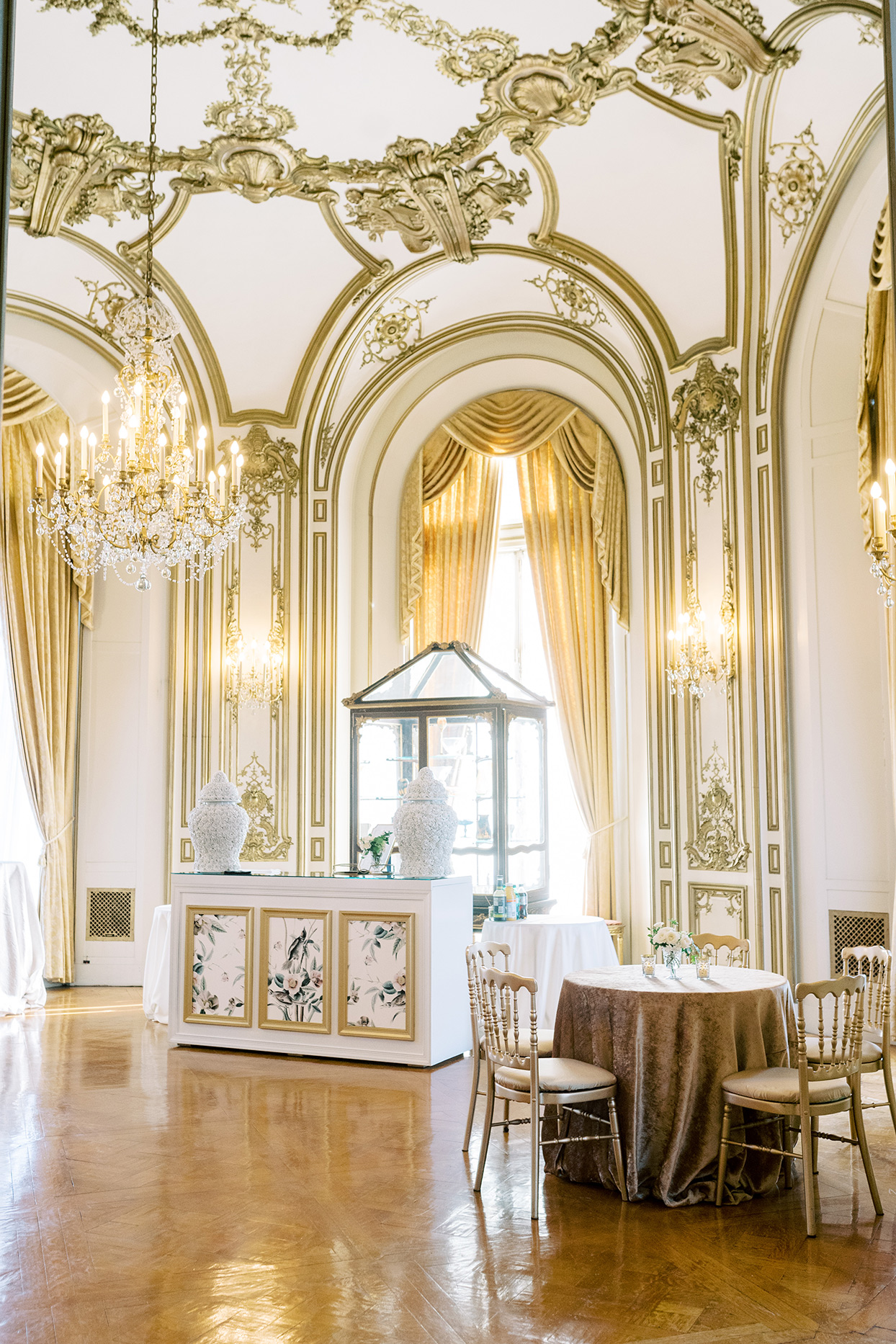 gold and white reception space