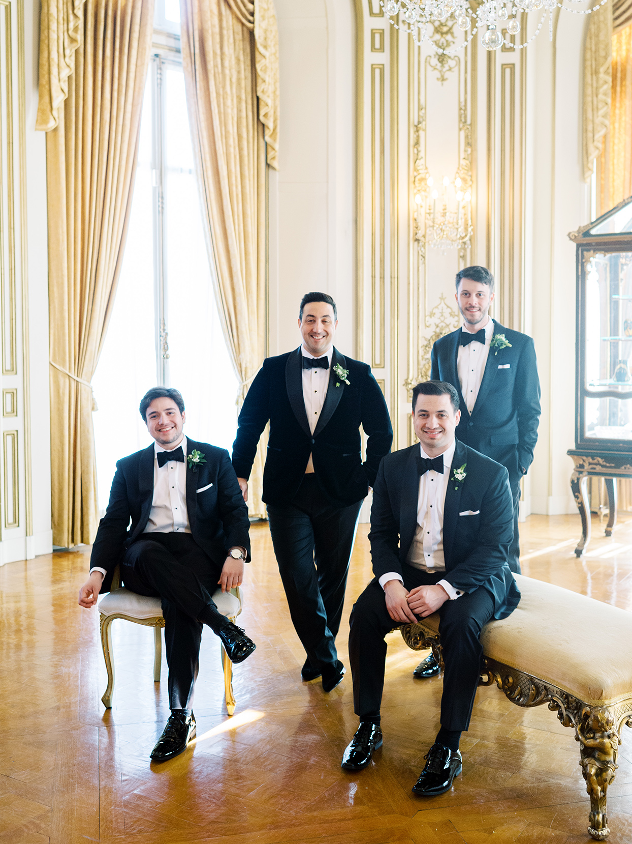 Groom and groomsmen in black tuxes from Monetti Tailoring