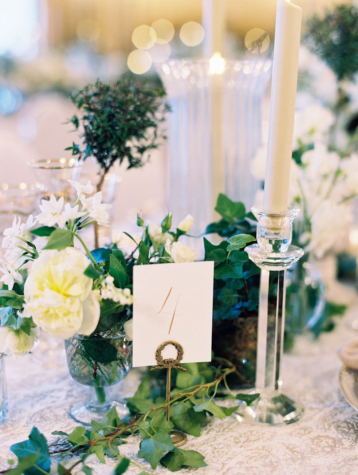 table numbers on vintage stand at wedding reception