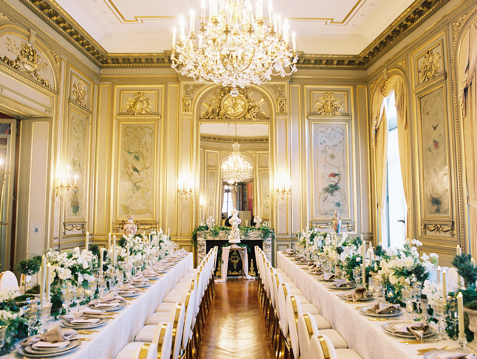 long tables with white linens at wedding reception