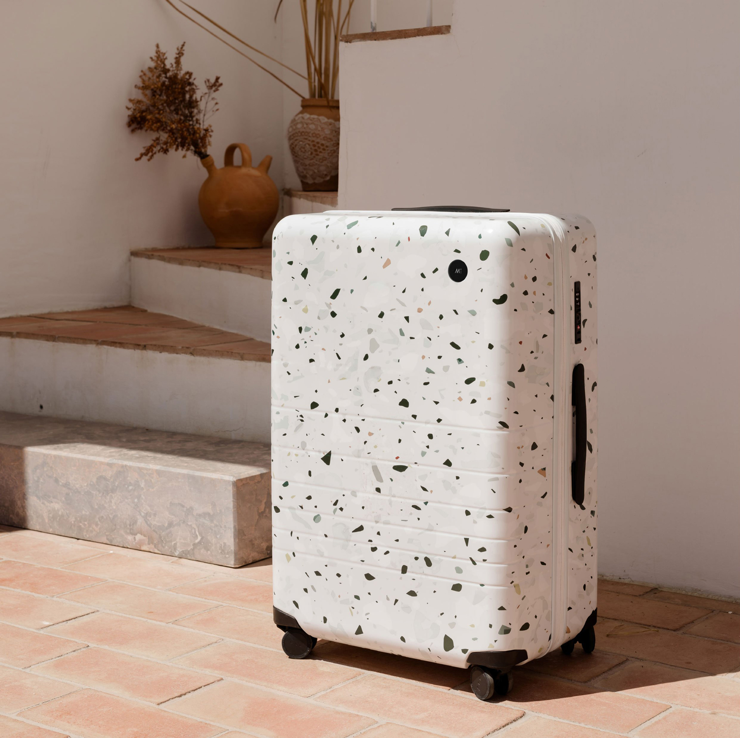 monos suitcase with speck pattern