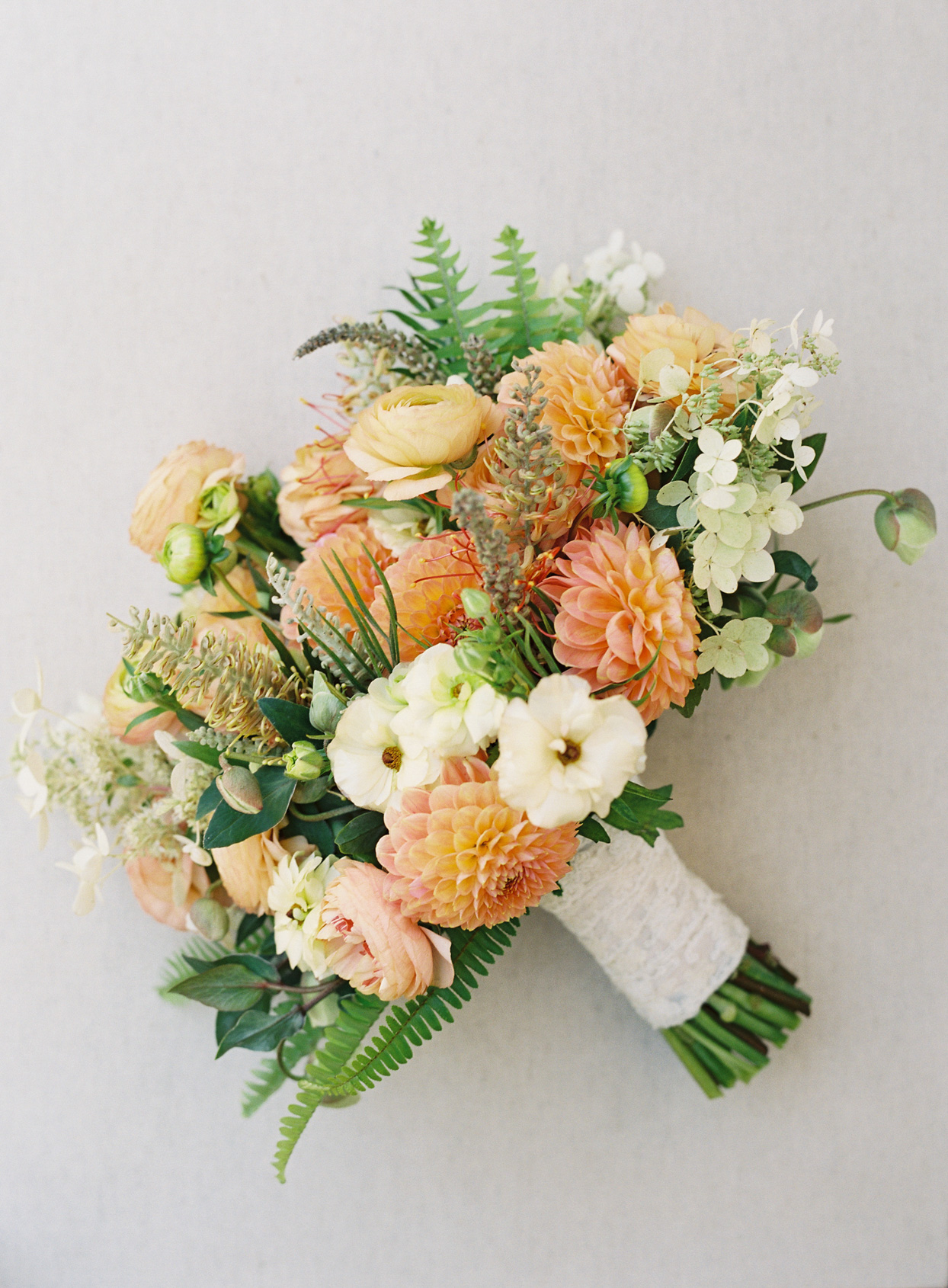orange and cream colored floral wedding bouquet