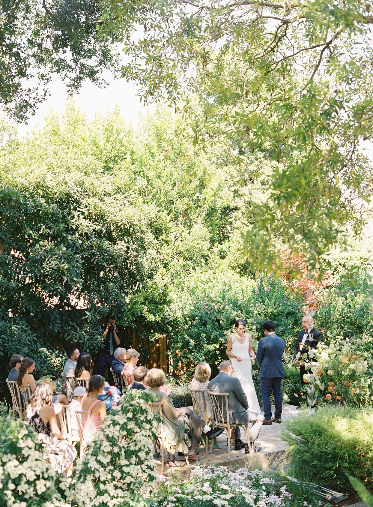 couple reading vows in small backyard wedding