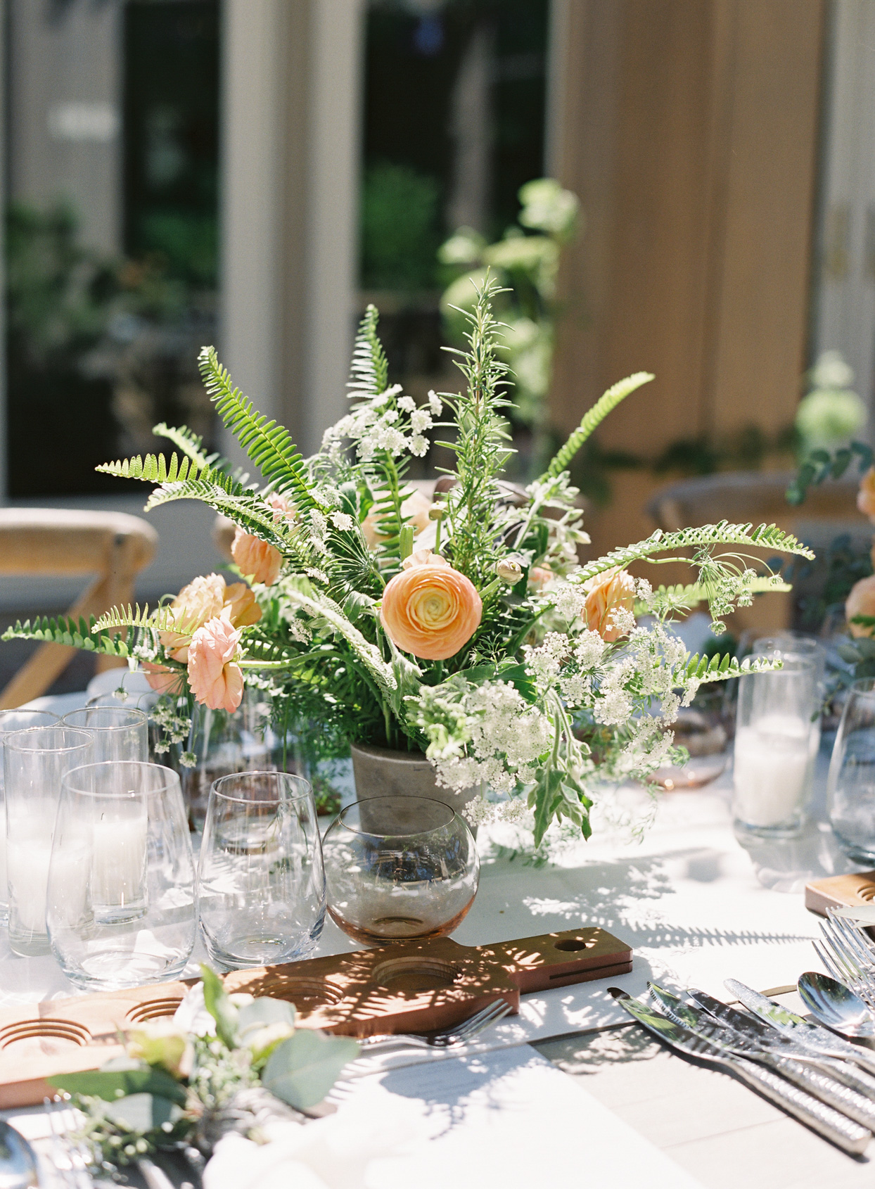 orange and white floral bouquet on wedding reception table