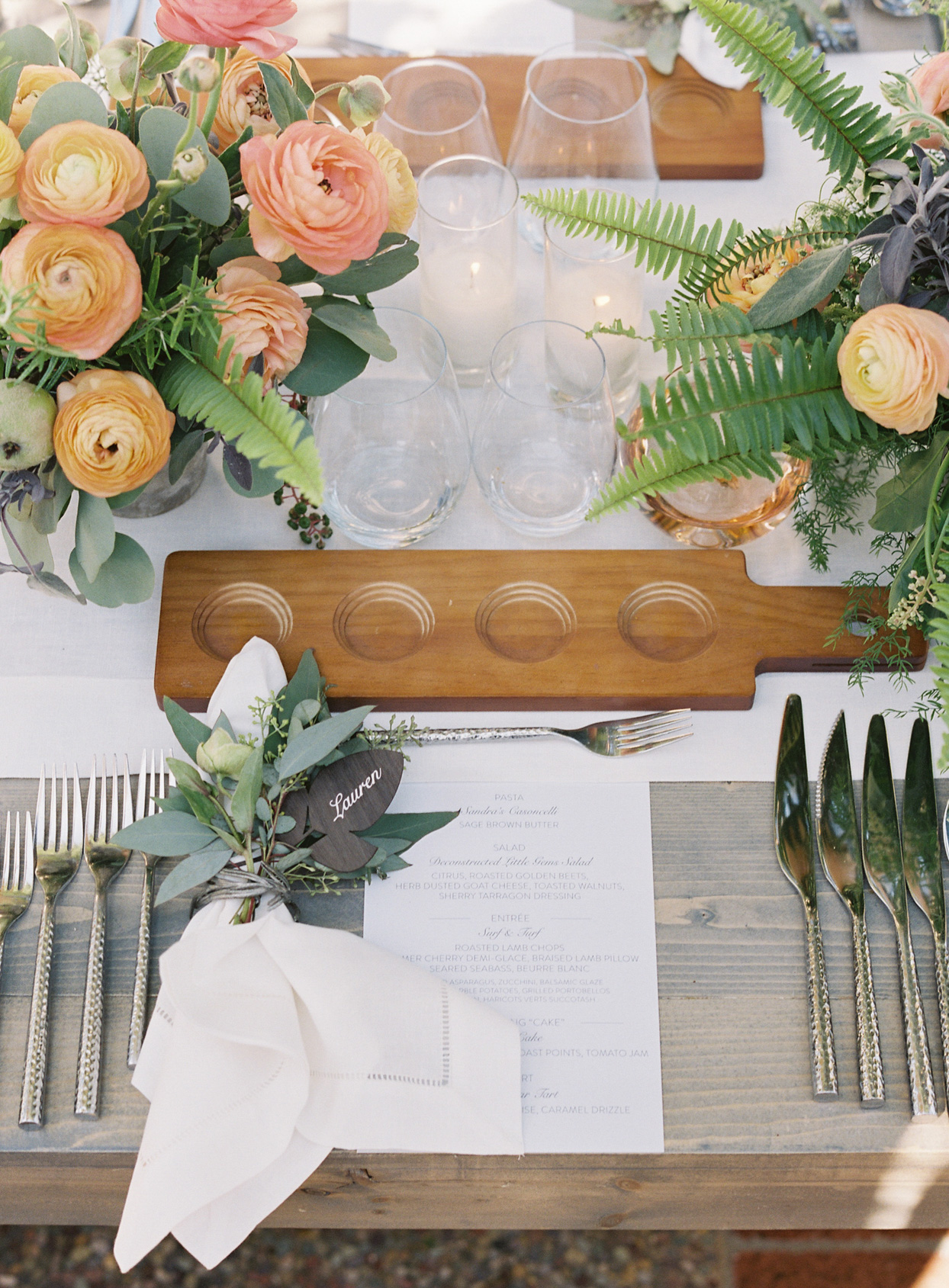 elegant reception table setting with white napkins and greenery
