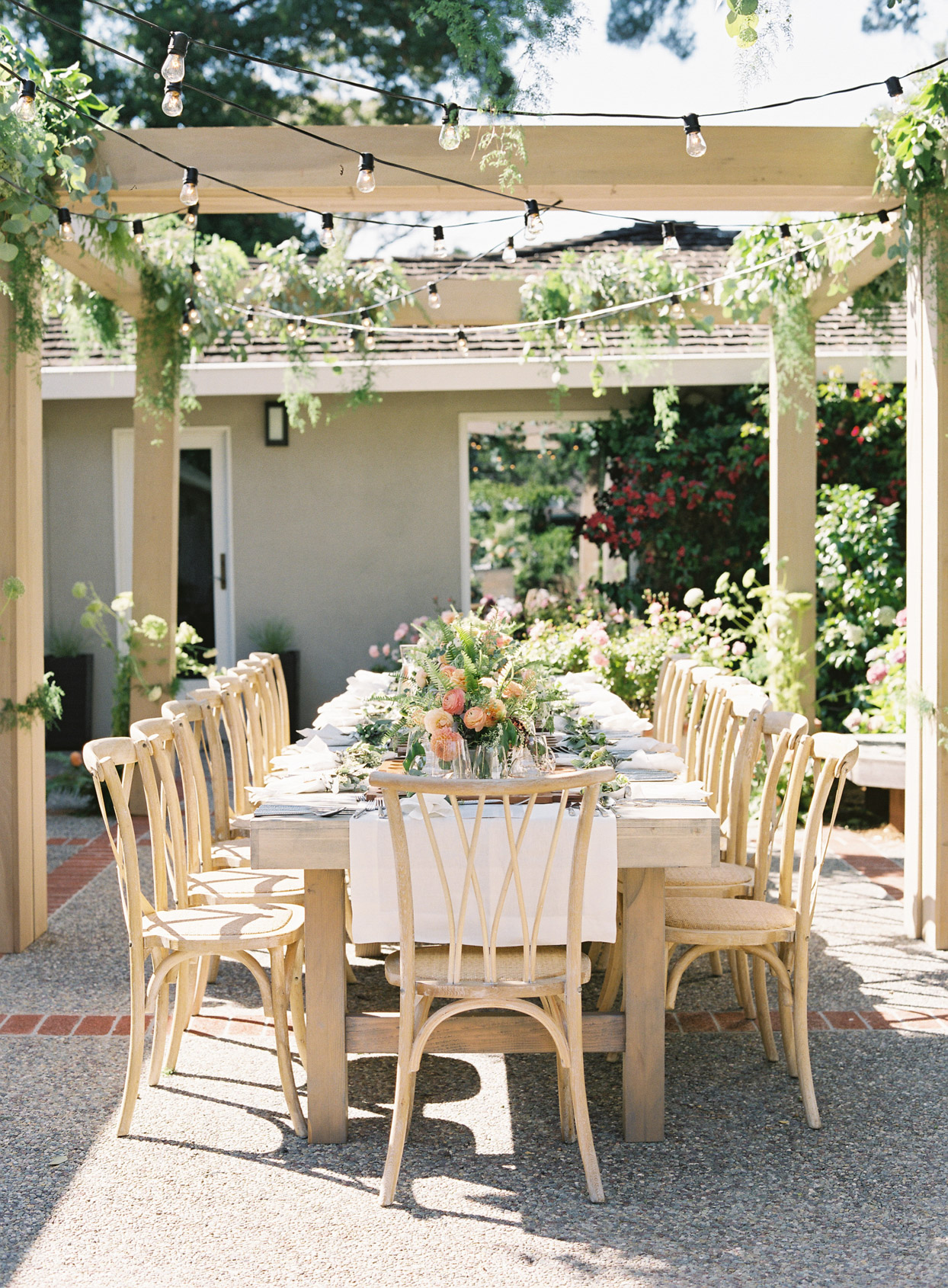 outdoor wedding reception table with string lights above
