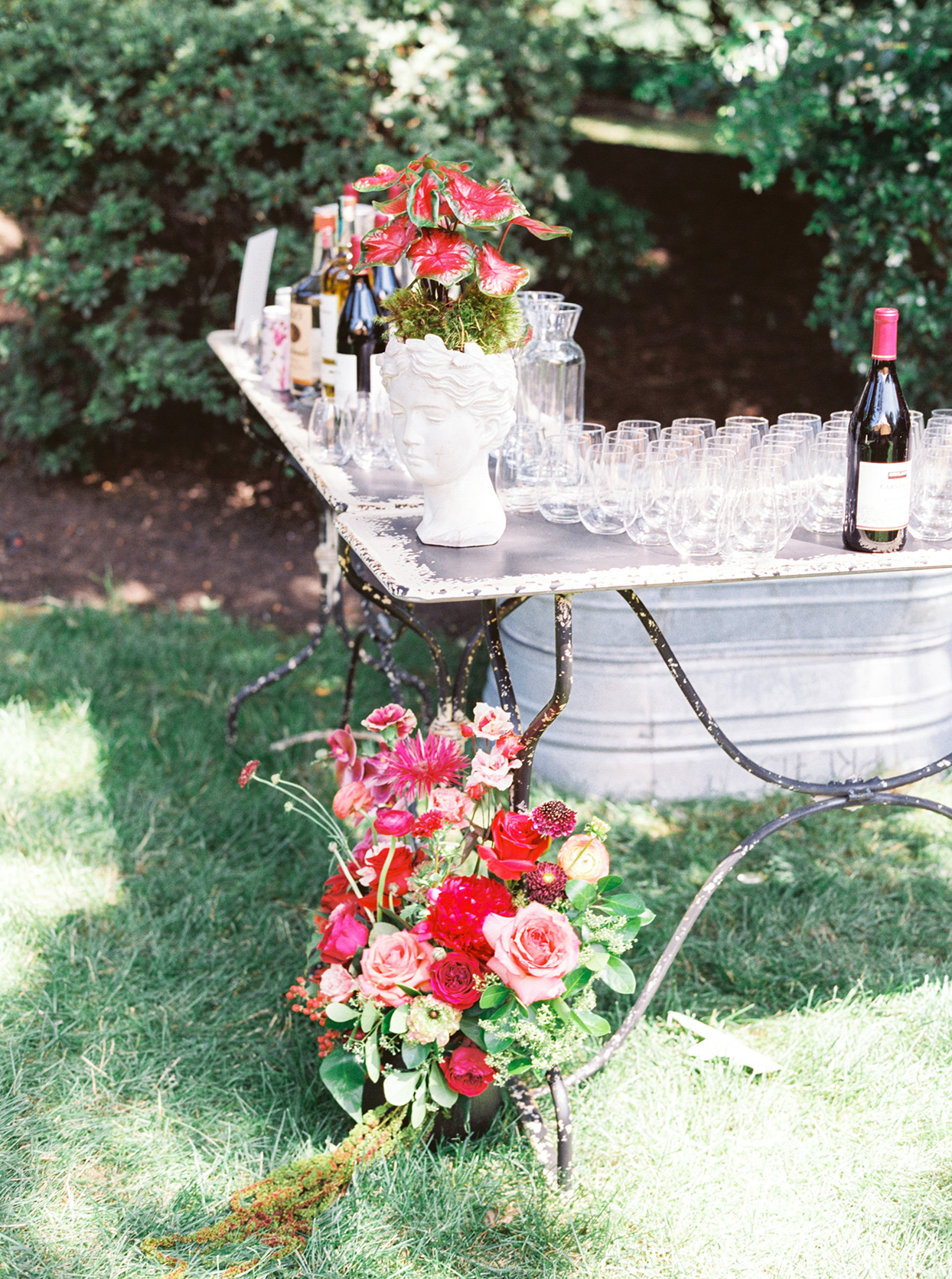 outdoor bridal shower bar with floral decor