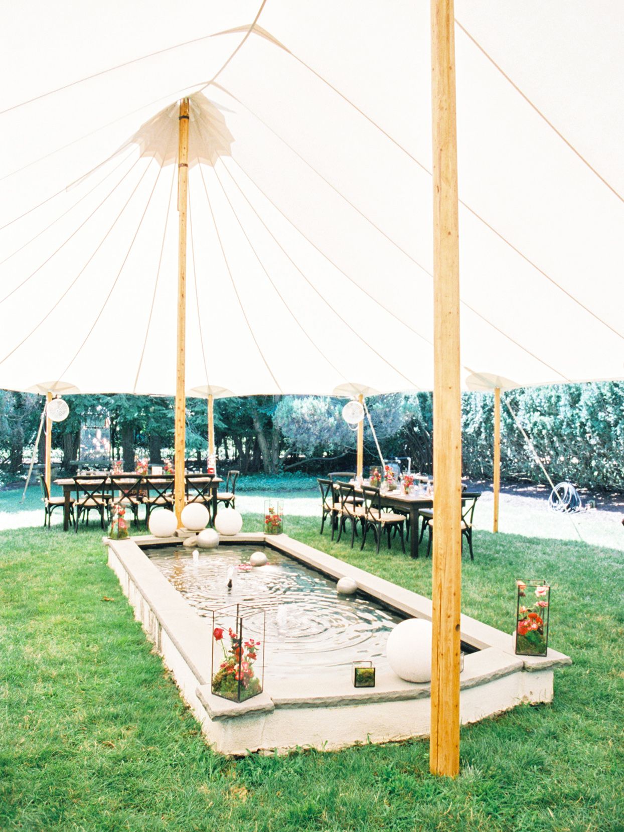 large white tent for bridal shower outside