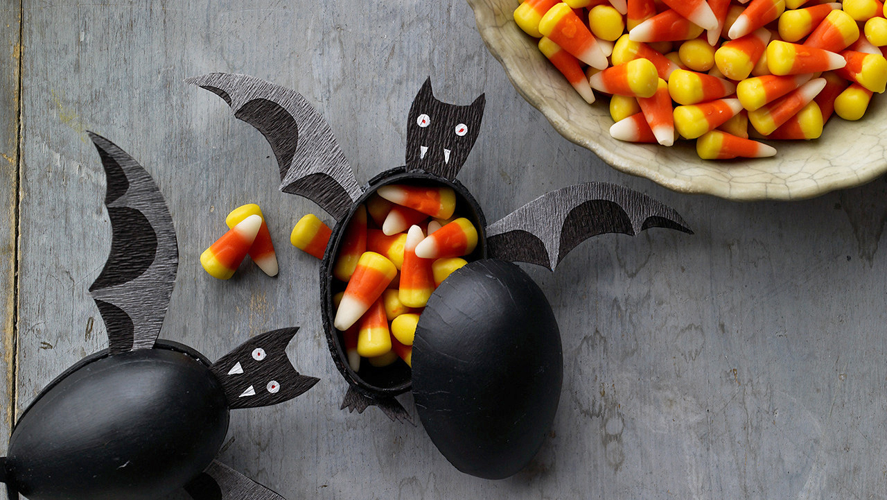 treat box decorated like bat with candy corns