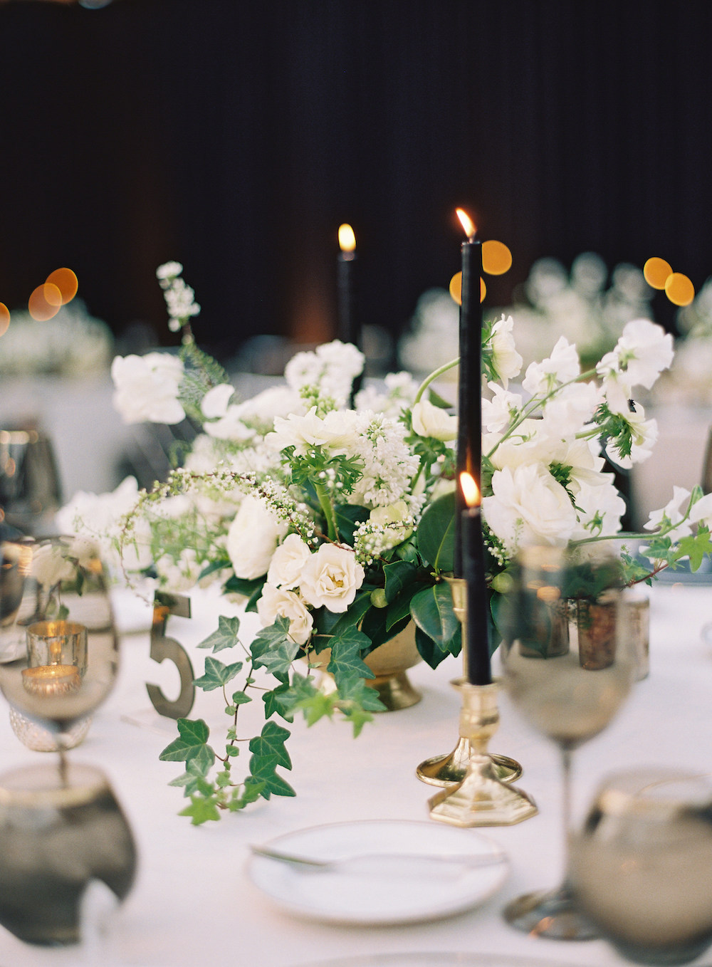 ivey trevor wedding reception flowers and candle tabletop decor