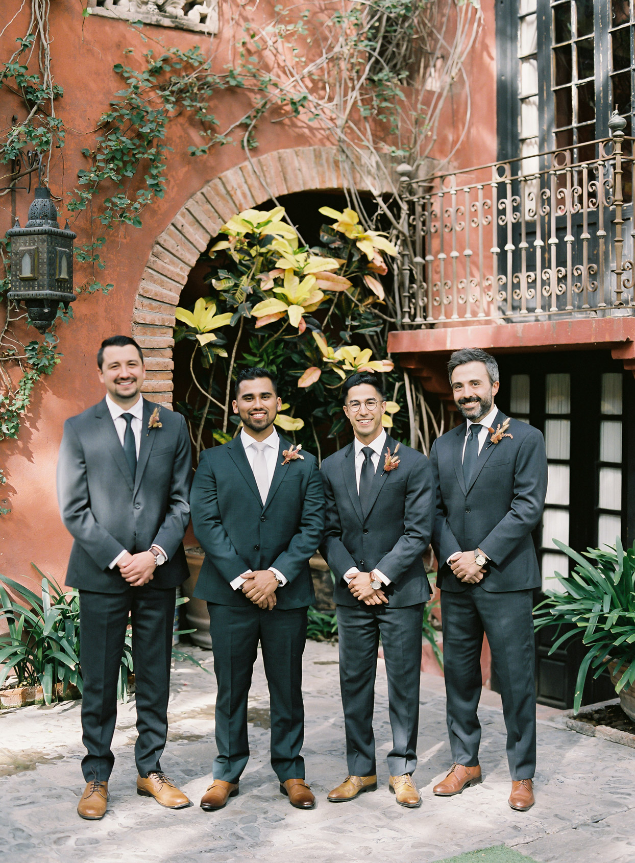wedding groomsmen in charcoal suits